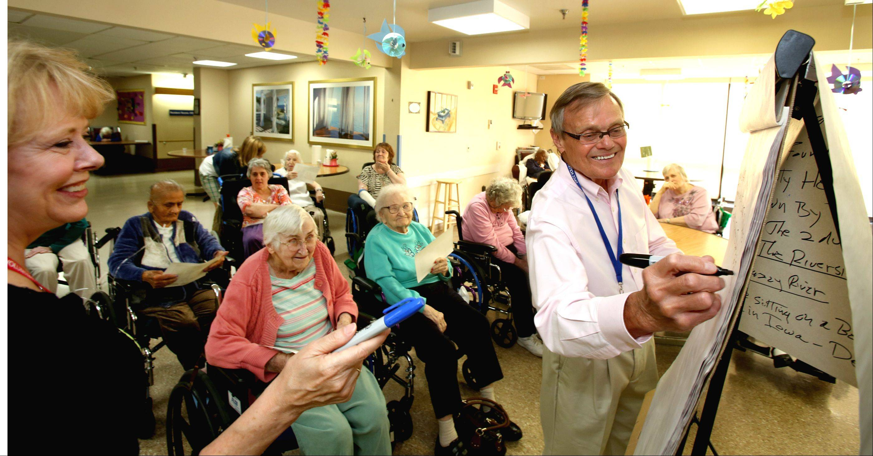 "Jane and Ron Reinecke of West Chicago create a story with residents of the DuPage Convalescent Center in a program called ""Time Slips."""