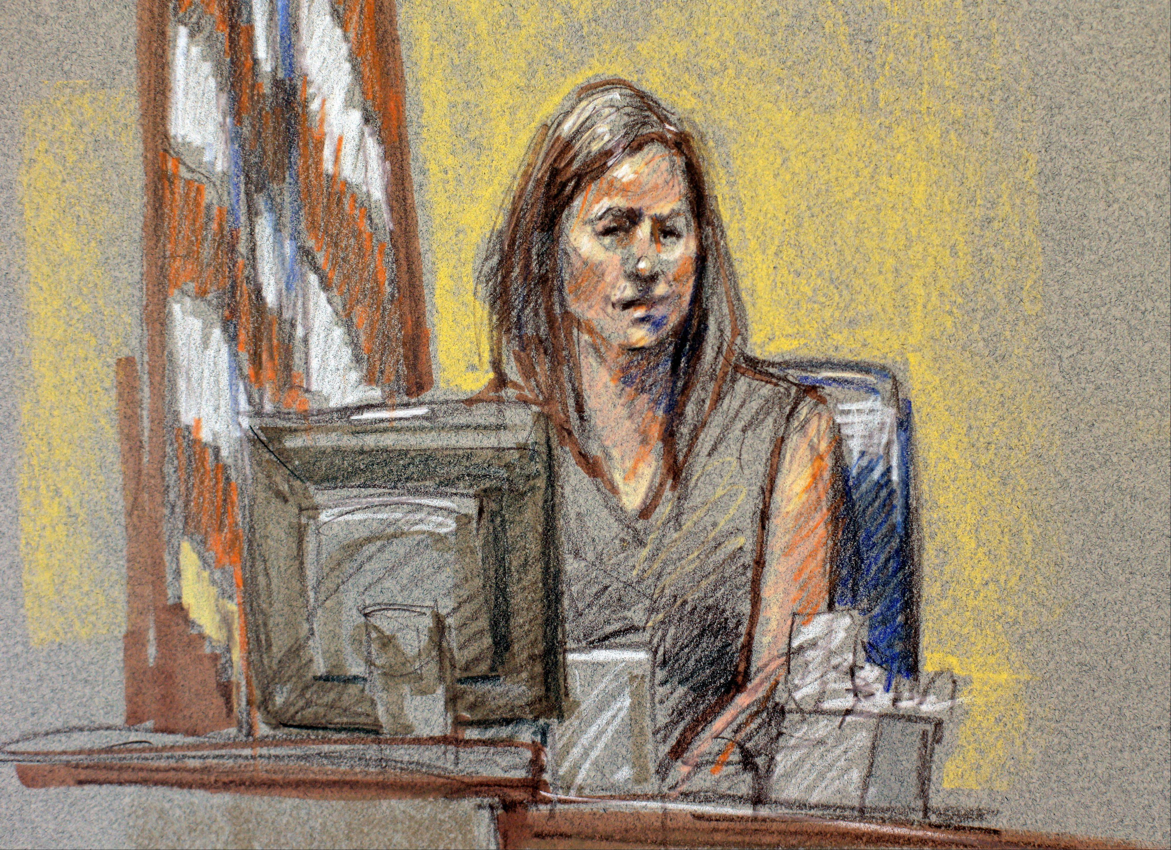 Angela Rivera, wife of Maj. Libardo Caraveo who was one of 13 people killed in the Fort Hood shootings, appears on the witness stand during the sentencing phase for Maj. Nidal Hasan, Monday, August 26, 2013, in Fort Hood, Texas. The jury found Hasan unanimously guilty on the 13 charges of premeditated murder and he is eligible for the death penalty in the November 2009 attack at Ford Hood.
