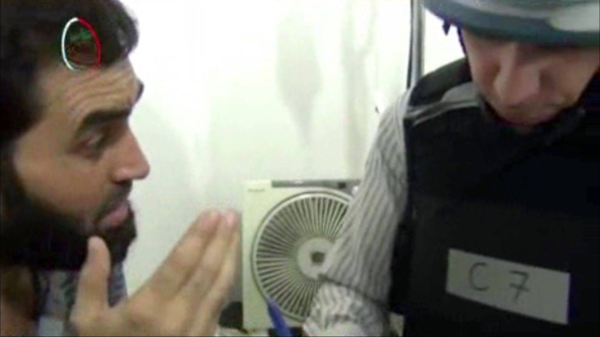 This undated image taken from amateur video footage provided by the Media Office Of Moadamiyeh purports to show a U.N. inspector, right, speaking to a man about the alleged chemical weapon attack as a U.N. inspection team visits a makeshift hospital in Moadamiyeh, a suburb of the Syrian capital of Damascus. Doctors Without Borders said 355 people were killed in an artillery barrage by regime forces on Wednesday that included the use of toxic gas. The media office of Moadamiyeh is a loosely organized Anti-Assad activist group based in Moadamieyh which posts video and still images of violence and other developments from the region. The Associated Press cannot absolutely certify the content, date, location or authenticity of this image.