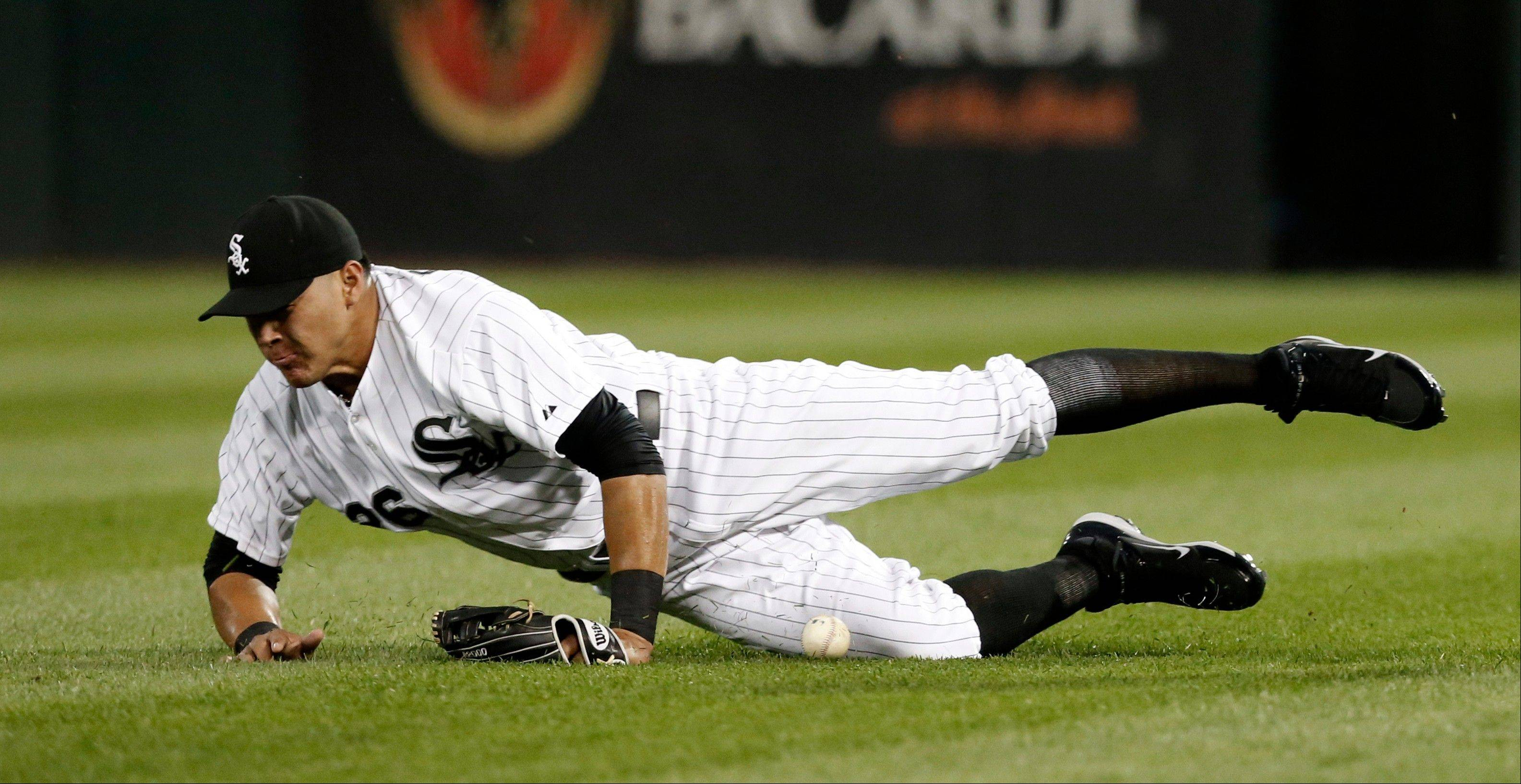 White Sox center fielder Avisail Garcia is unable to catch a fly ball hit by Houston Astros' Jonathan Villar during the third inning of a baseball game Tuesday, Aug. 27, 2013, in Chicago.