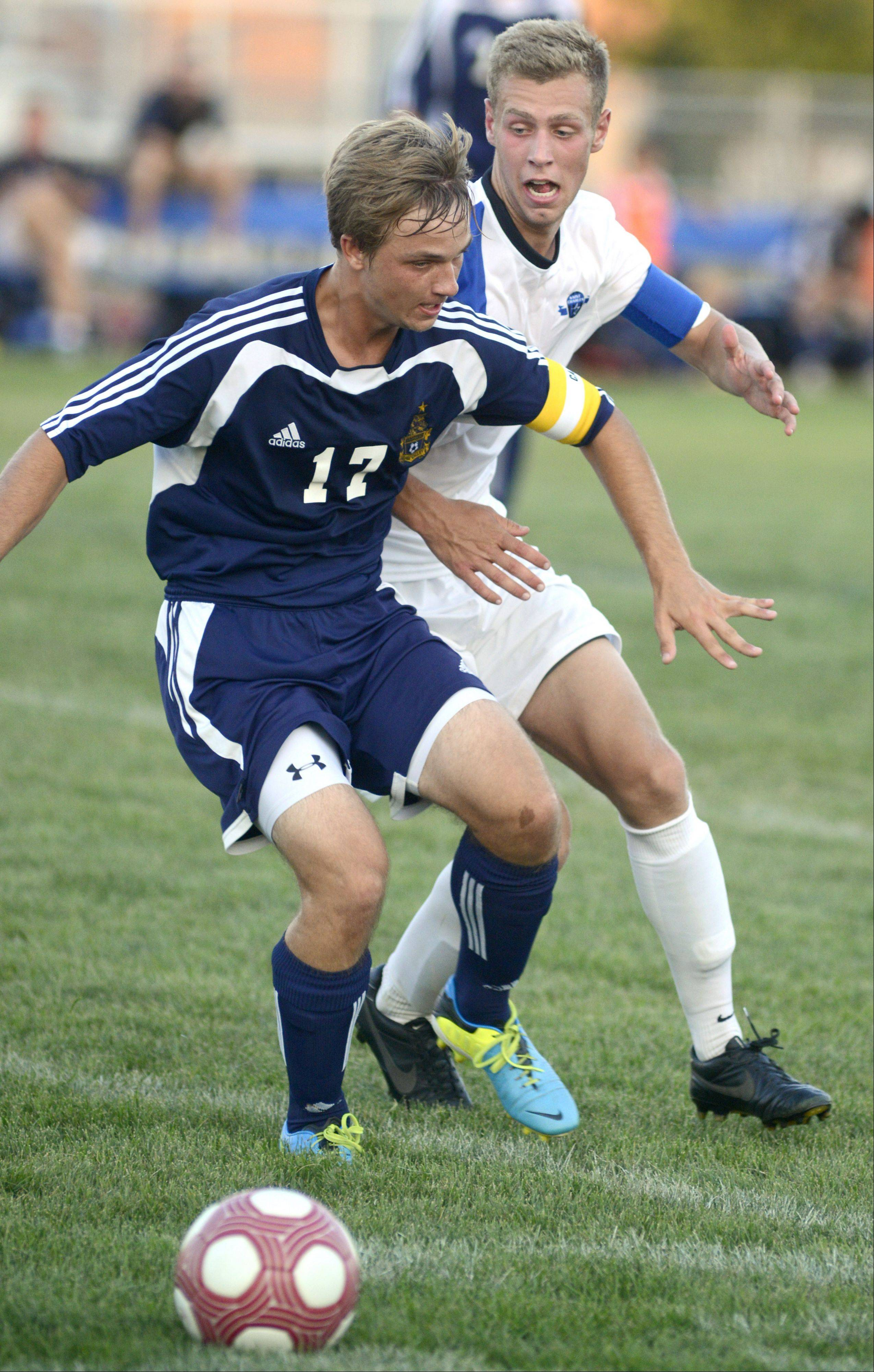 Neuqua Valley's Nick Castelvecchi fights off St. Charles North's Phillip LeGare in the first half on Tuesday, August 27.
