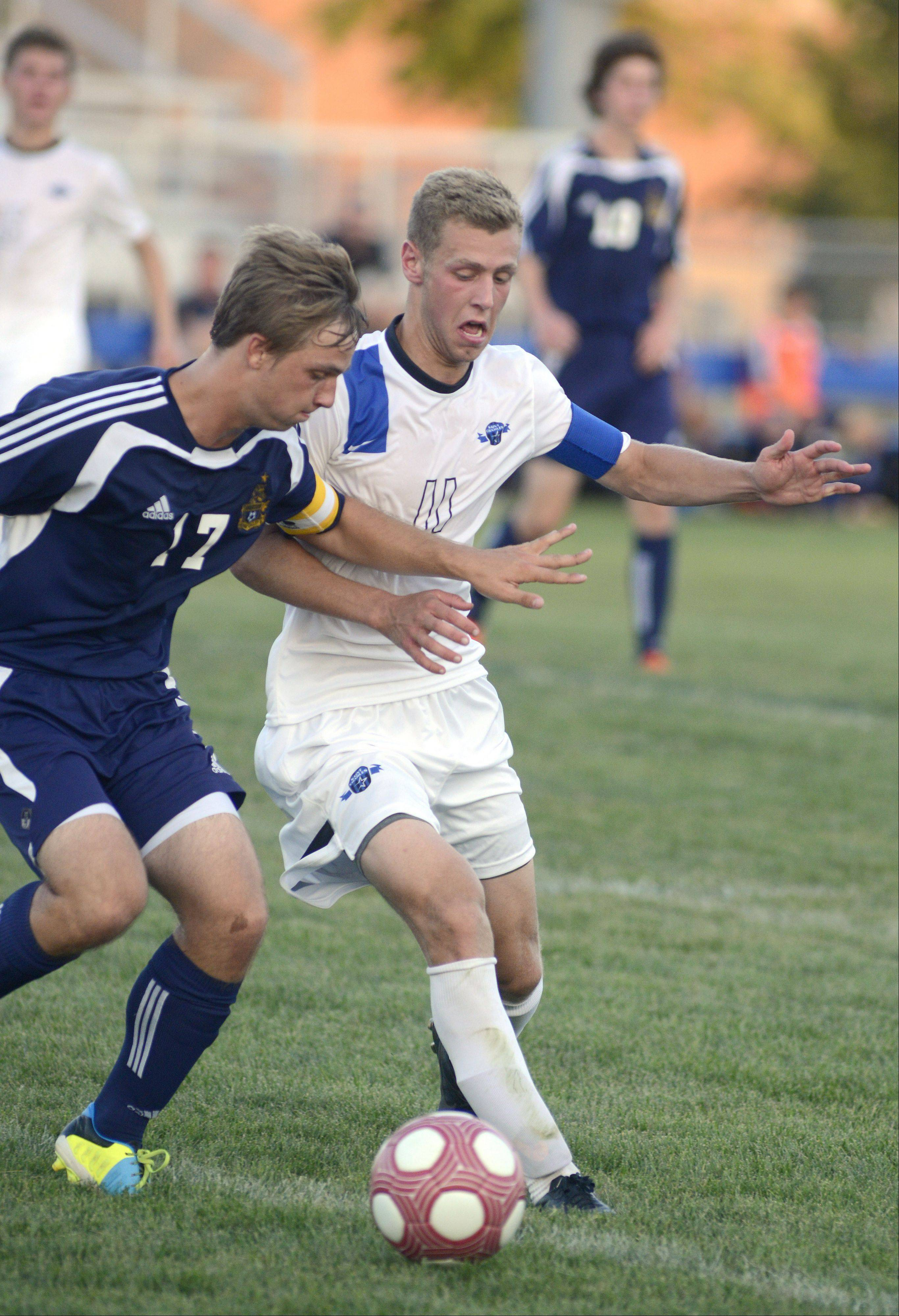 Neuqua Valley's Nick Castelvecchi and St. Charles North's Phillip LeGare fight for possession of the ball in the first half on Tuesday, August 27.