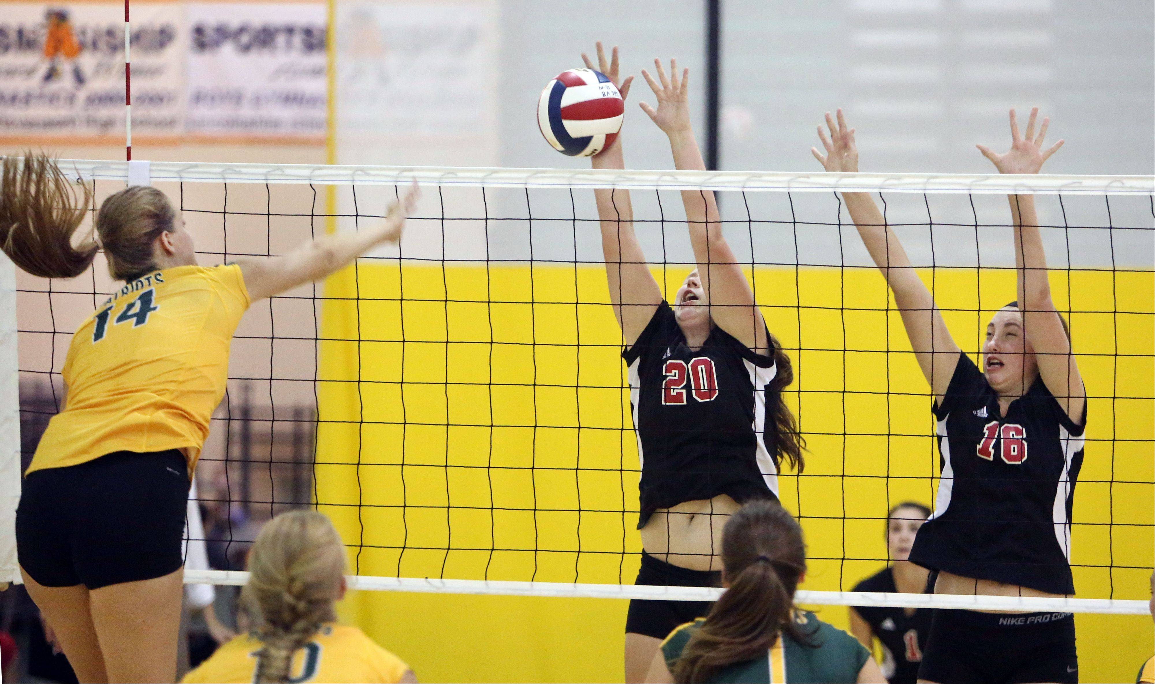 Stevenson's Kara Maleski, left, spikes one at Barrington's Sarah Berggren and Megan Talbot on Tuesday night at Stevenson.