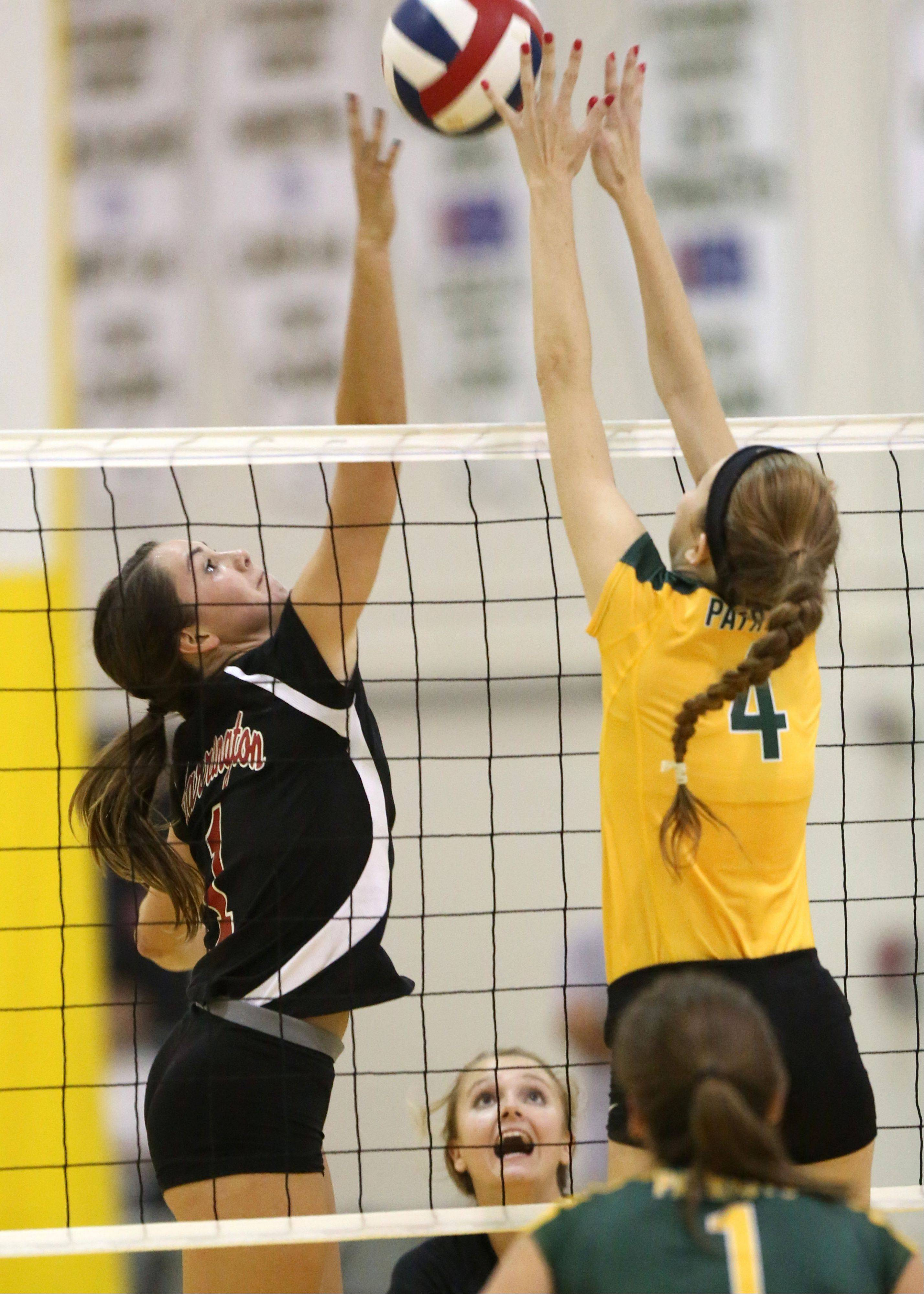 Barrington's Claire Waliczek, left, and Stevenson's Grace Duffy meet at the net during their game Tuesday night at Stevenson.