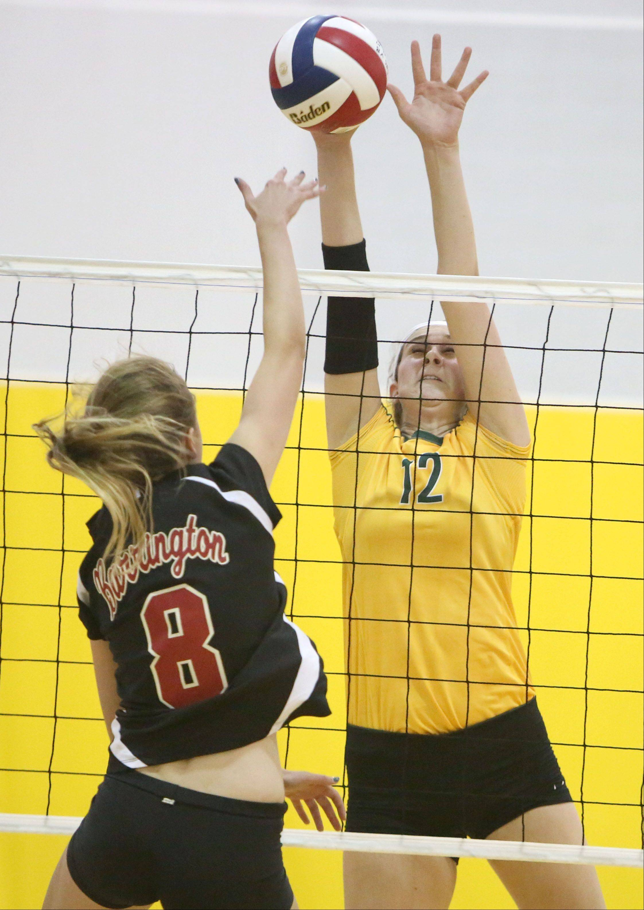 Barrington's Tina Bergmann, left, and Stevenson's Julia Osmond meet at the net Tuesday night at Stevenson.