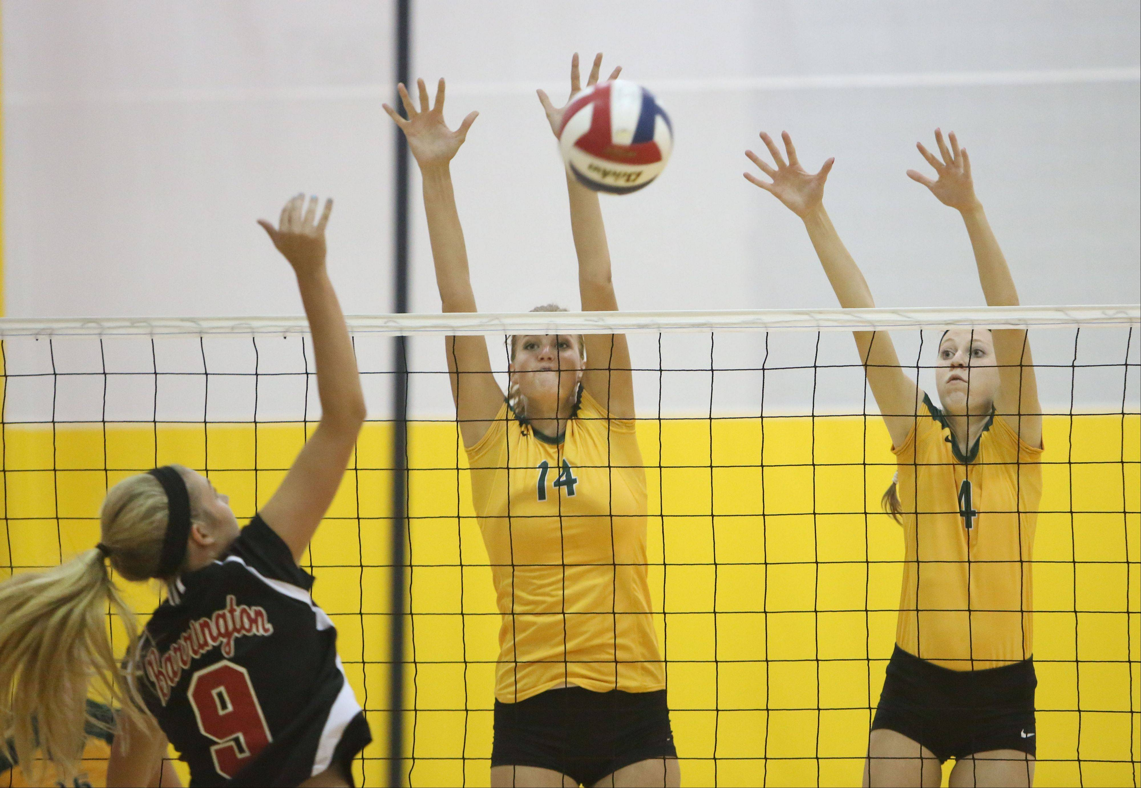 Barrington's Emily Watkins, left, spikes one at Stevenson's Kara Maleski and Grace Duffy on Tuesday night at Stevenson.