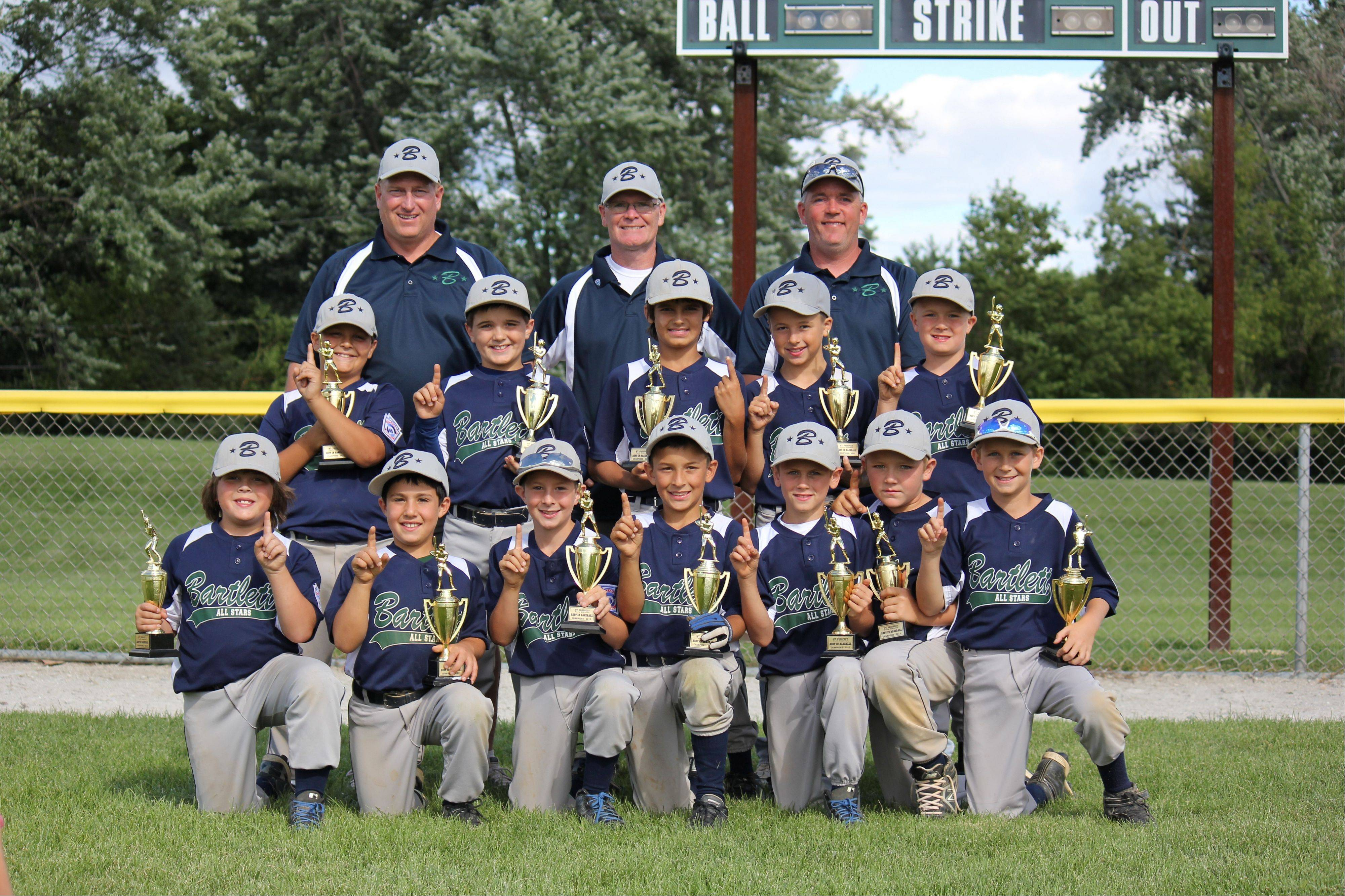 The Bartlett Blue 9U, from left, are: Front row: Josh Schuberth, Rocco Tenuta, Hayden Cook, Alex Mallinas, Aaron Wafford, Patrick Nelson and Jack Sampey; second row: Johnny Jiminez, Danny Angelone, Sam Atkins, Owen Cutinello and Kyle Swalley; third row: Coach John Wafford, coach Ron Nelson and coach Rob Swalley. Not pictured is head coach Shane Cook.