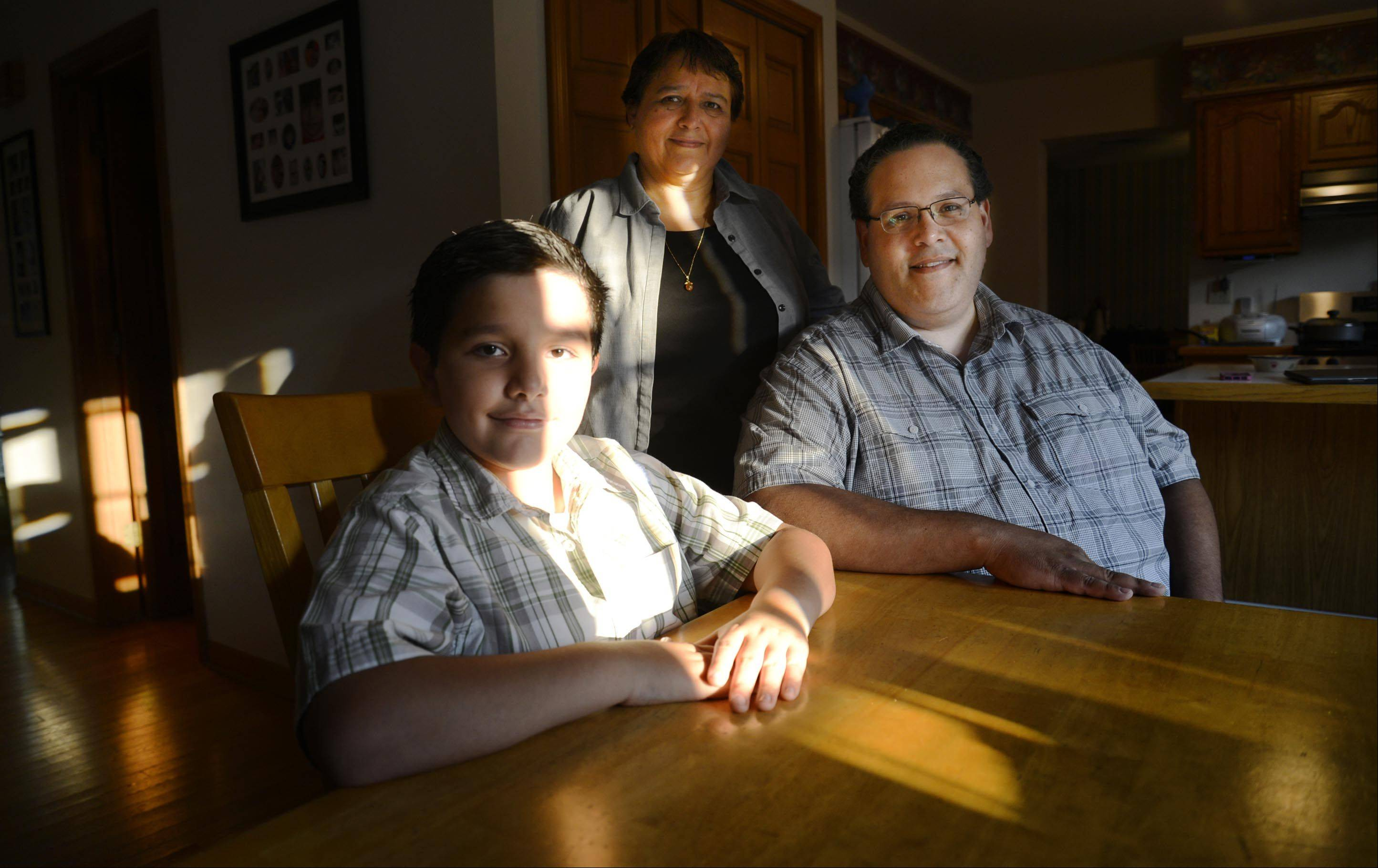 Luis Macias of Elgin directed �Embracing Dyslexia,� a documentary about dyslexia that will premiere Saturday in Elgin. His son Alejandro, 11, has dyslexia. In this photo, Alejandra poses with his father and mother Magdalena.