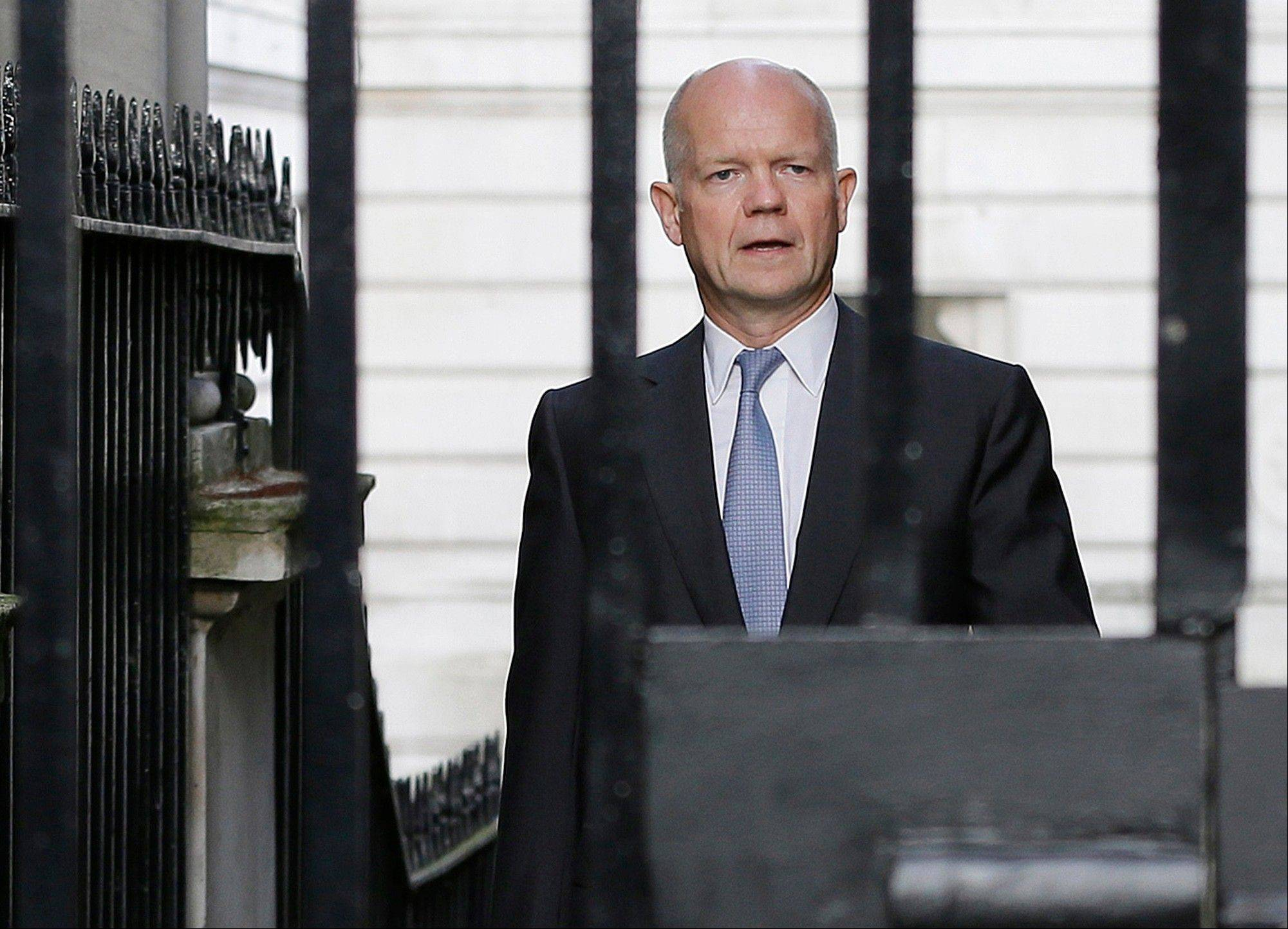 Britain Foreign Secretary William Hague walks to Downing Street Wednesday ahead of a national security meeting to be held at the Cabinet office with Prime Minister David Cameron on the situation in Syria. The U.S. and international partners were unlikely to undertake military action before Thursday. That�s when Cameron will convene an emergency meeting of Parliament, where lawmakers were expected to vote on a motion clearing the way for a British response.