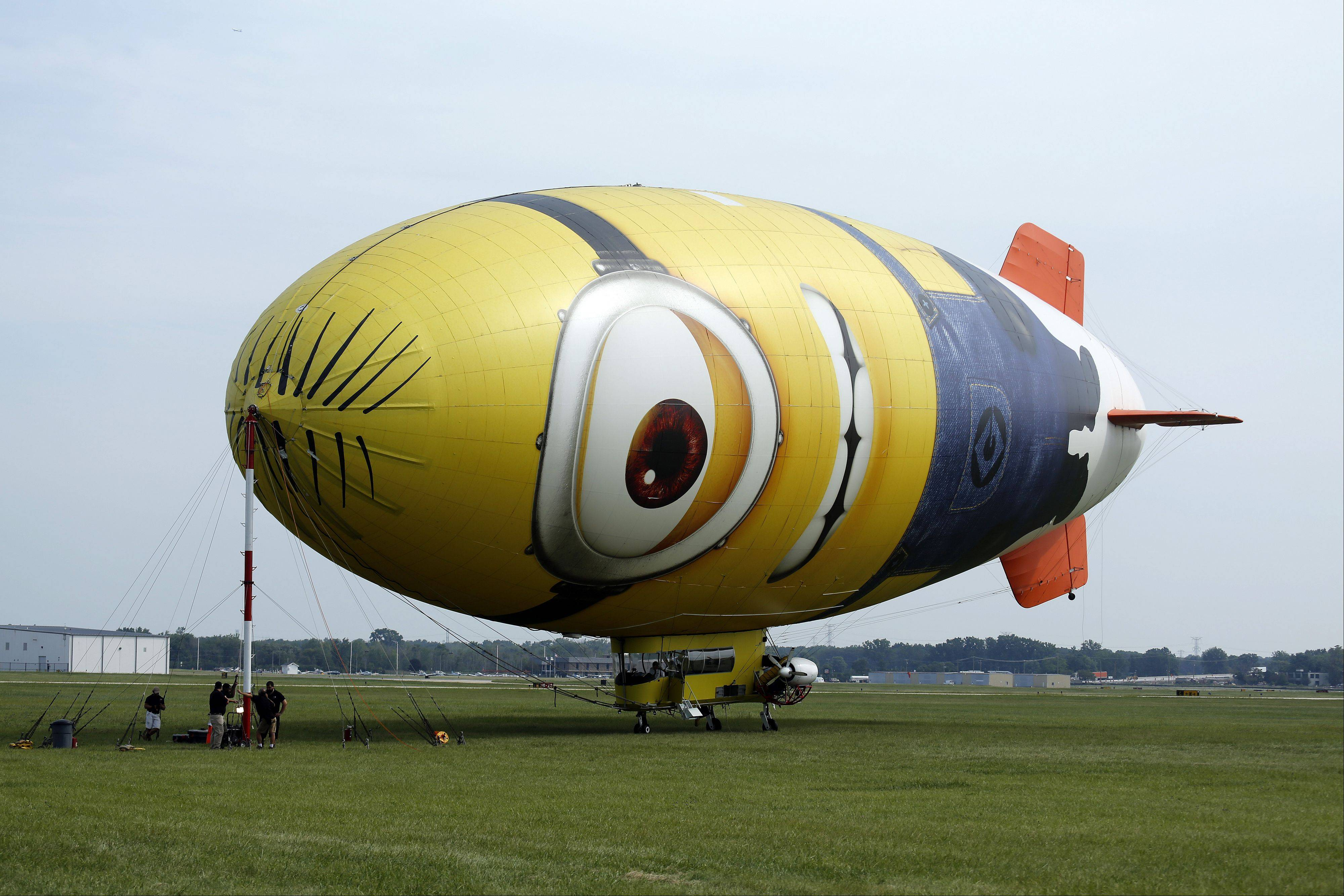 A blimp masquerading as a minion from the �Despicable Me� movies toured the air space above the Tri-Cities and DuPage County on Tuesday during a short stop at the DuPage Airport in West Chicago. Allan Patrick Judd, who has been flying since he was 16 and before he could drive a car, is the pilot that has been steering the Minion Balloon on its cross-country tour promoting the movie.