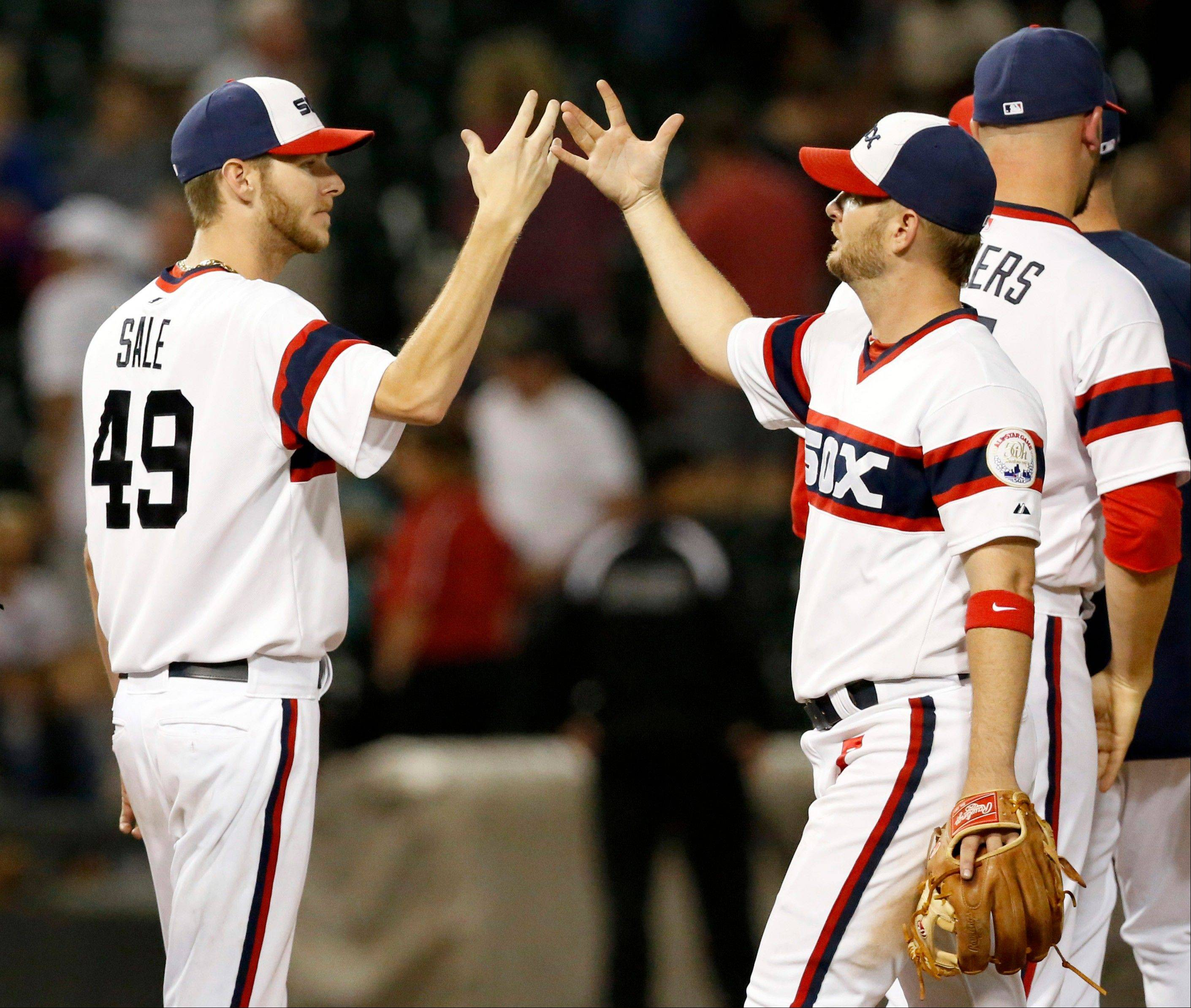 White Sox starting pitcher Chris Sale celebrates with third baseman Jeff Keppinger after their victory over the Astros on Wednesday night.