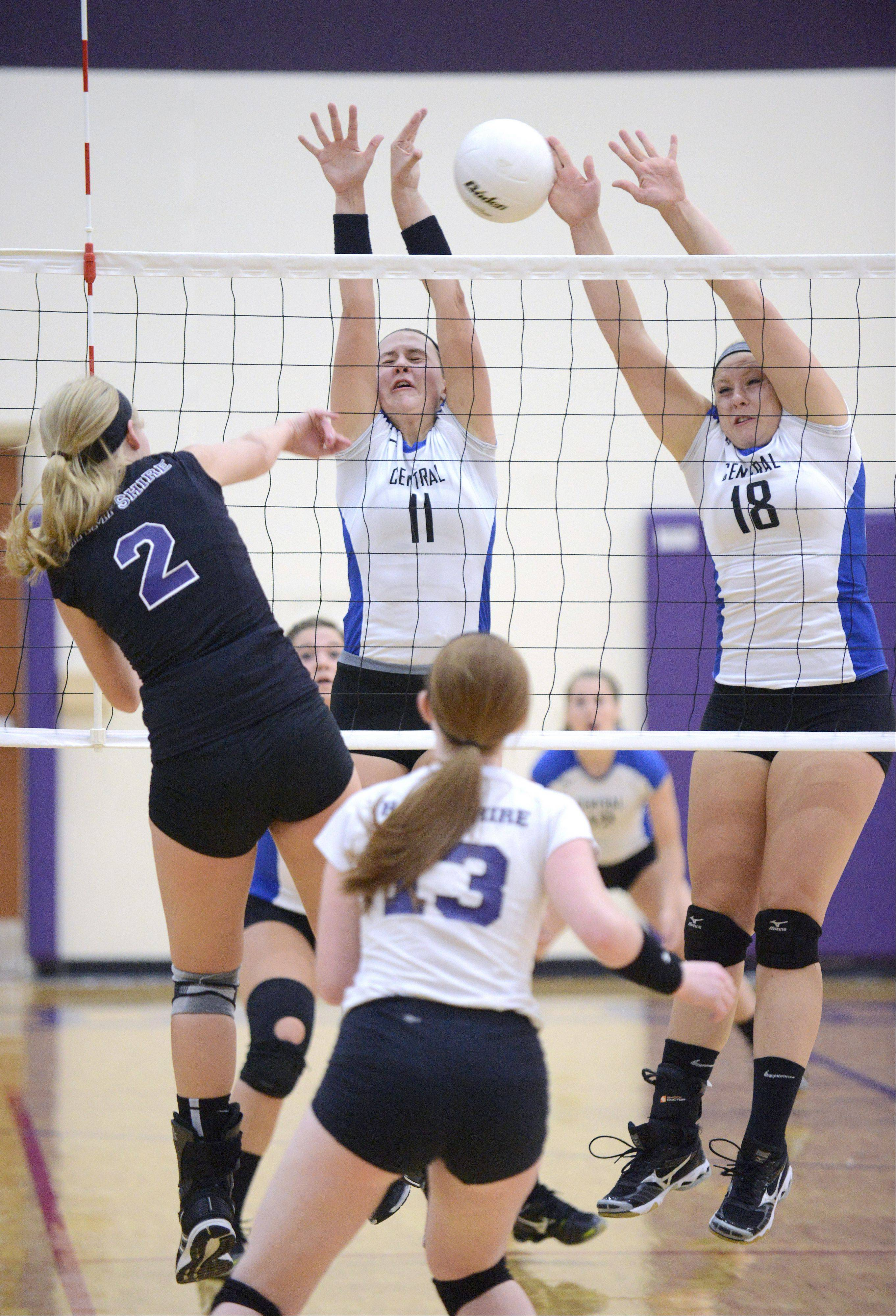 Burlington Central�s Caiti Seibert, left, and Makenna Jensen block a spike by Hampshire�s Erin Foss Wednesday at Hampshire.
