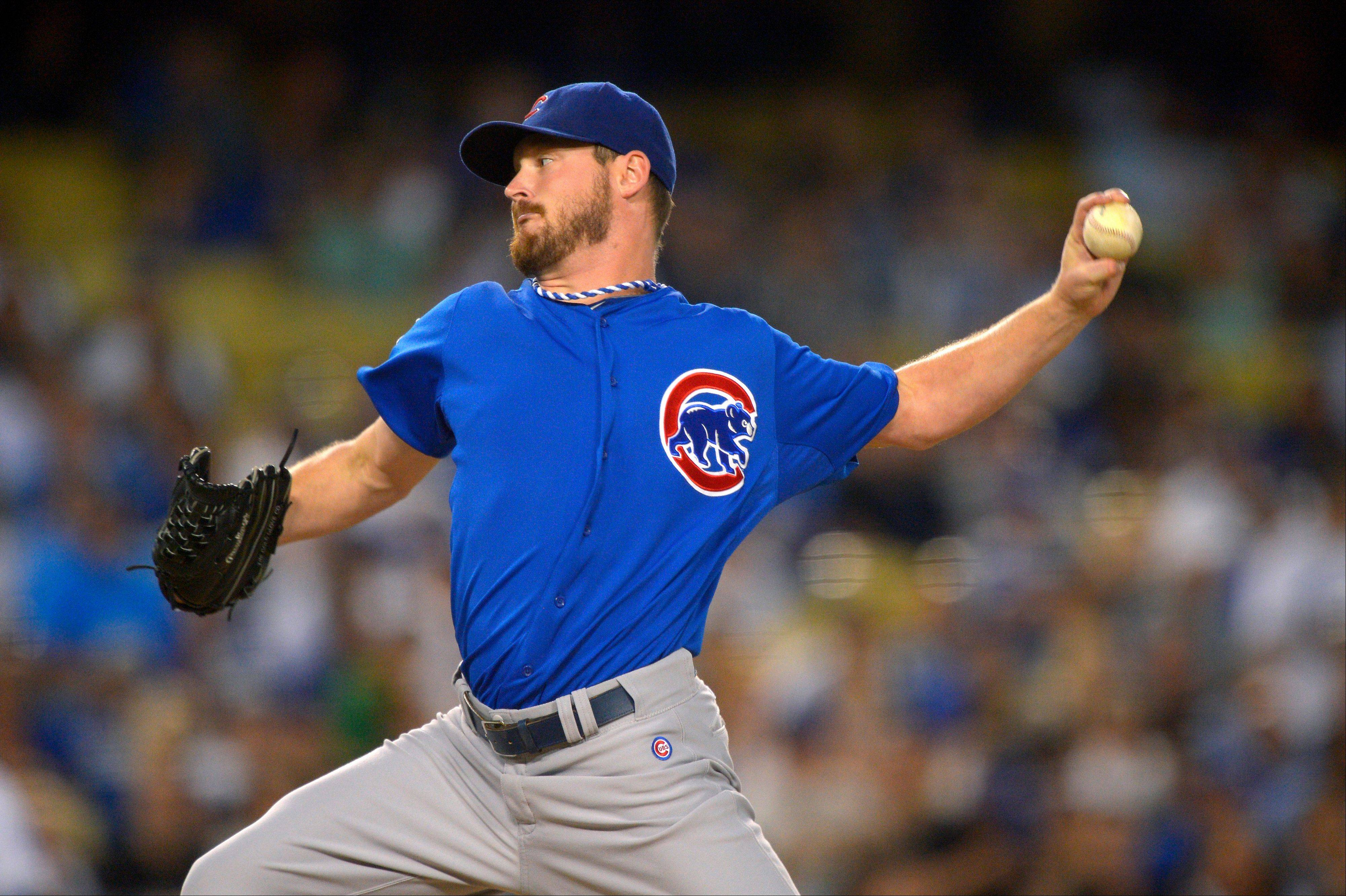 Chicago Cubs starting pitcher Travis Wood throws to the plate during the first inning of their baseball game against the Los Angeles Dodgers, Tuesday, Aug. 27, 2013, in Los Angeles. (AP Photo/Mark J. Terrill)