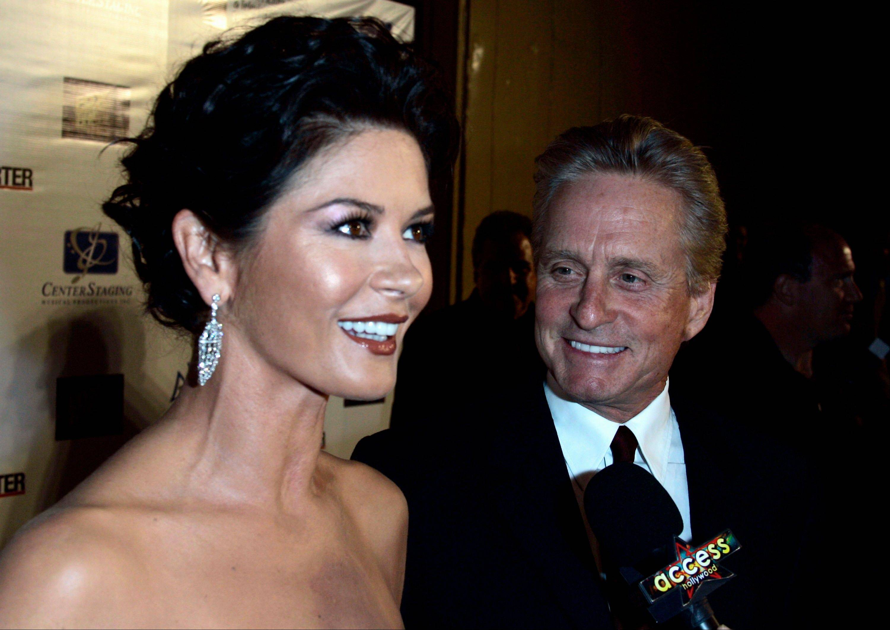 "Publicist Cece Yorke, a spokeswoman for Catherine Zeta-Jones, left, says the actress and her husband, Michael Douglas, ""are taking some time apart to evaluate and work on their marriage."""