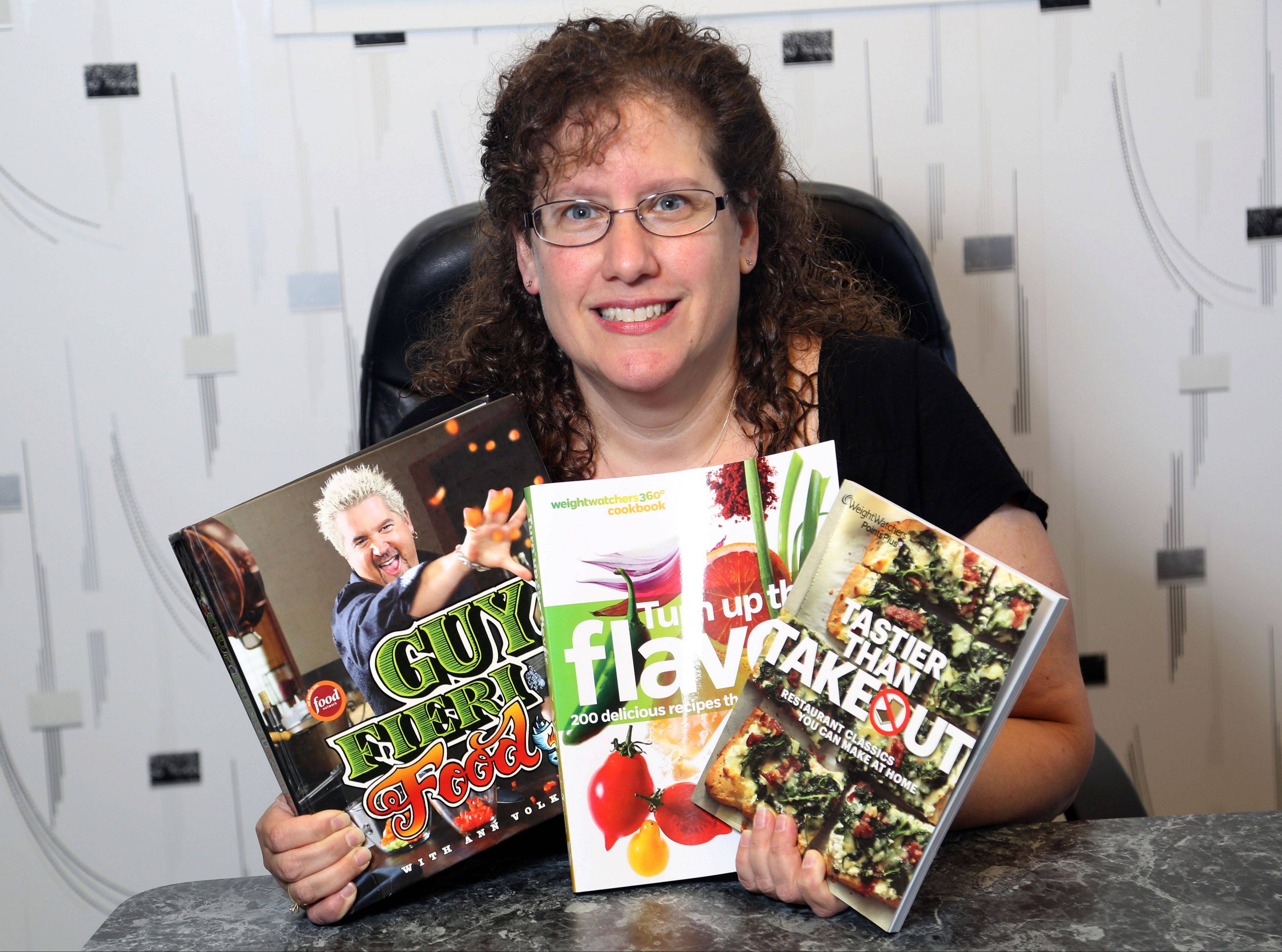 Dr. Karen Grobman of Buffalo Grove hold some of her favorite cook books. Grobman is one of 16 contestants in the Cook of the Week Challenge.