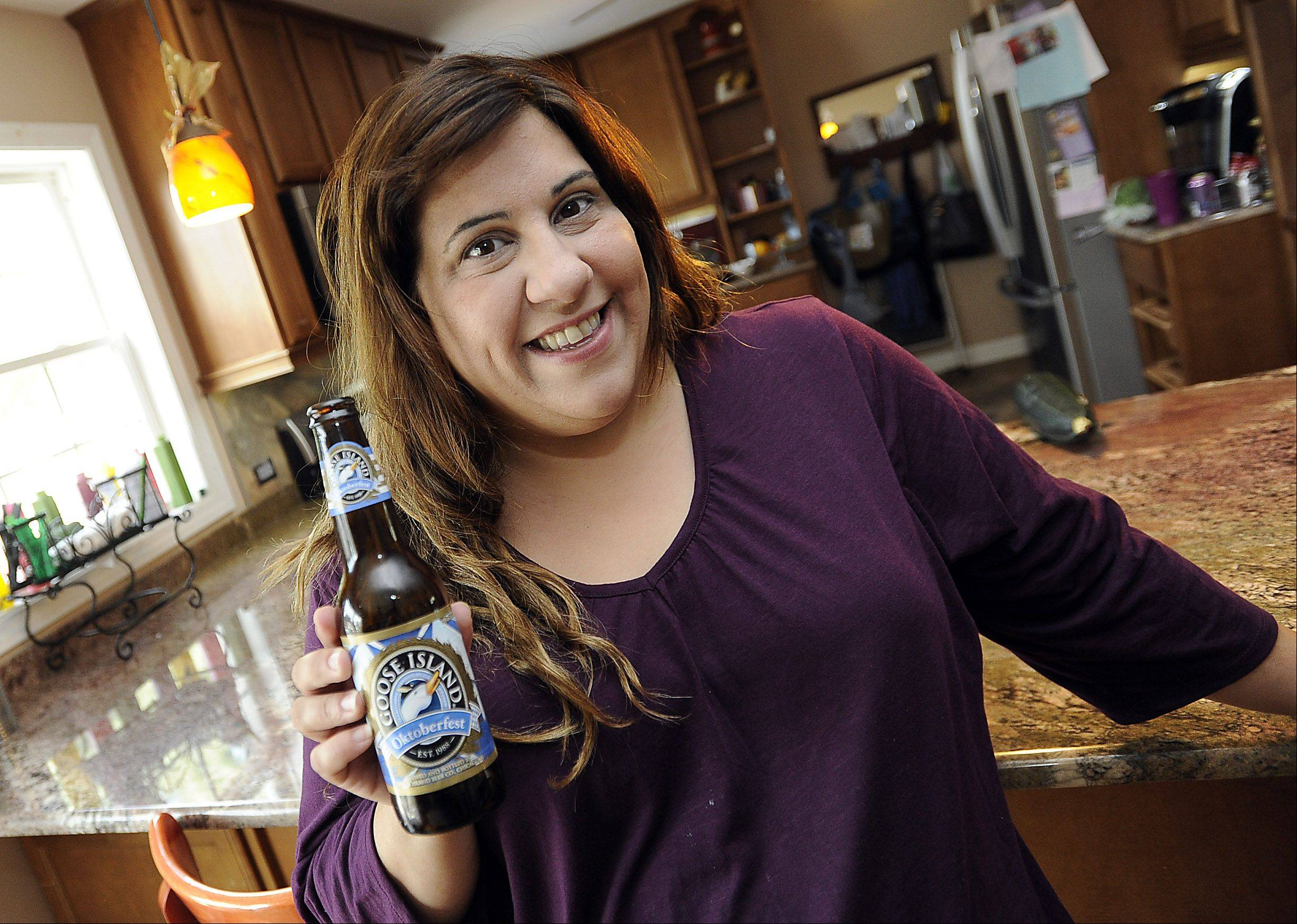 Cook of the Week Tina Garrett with her favorite ingredient to cook with and use in her food dishes, Goose Island Oktoberfest beer.