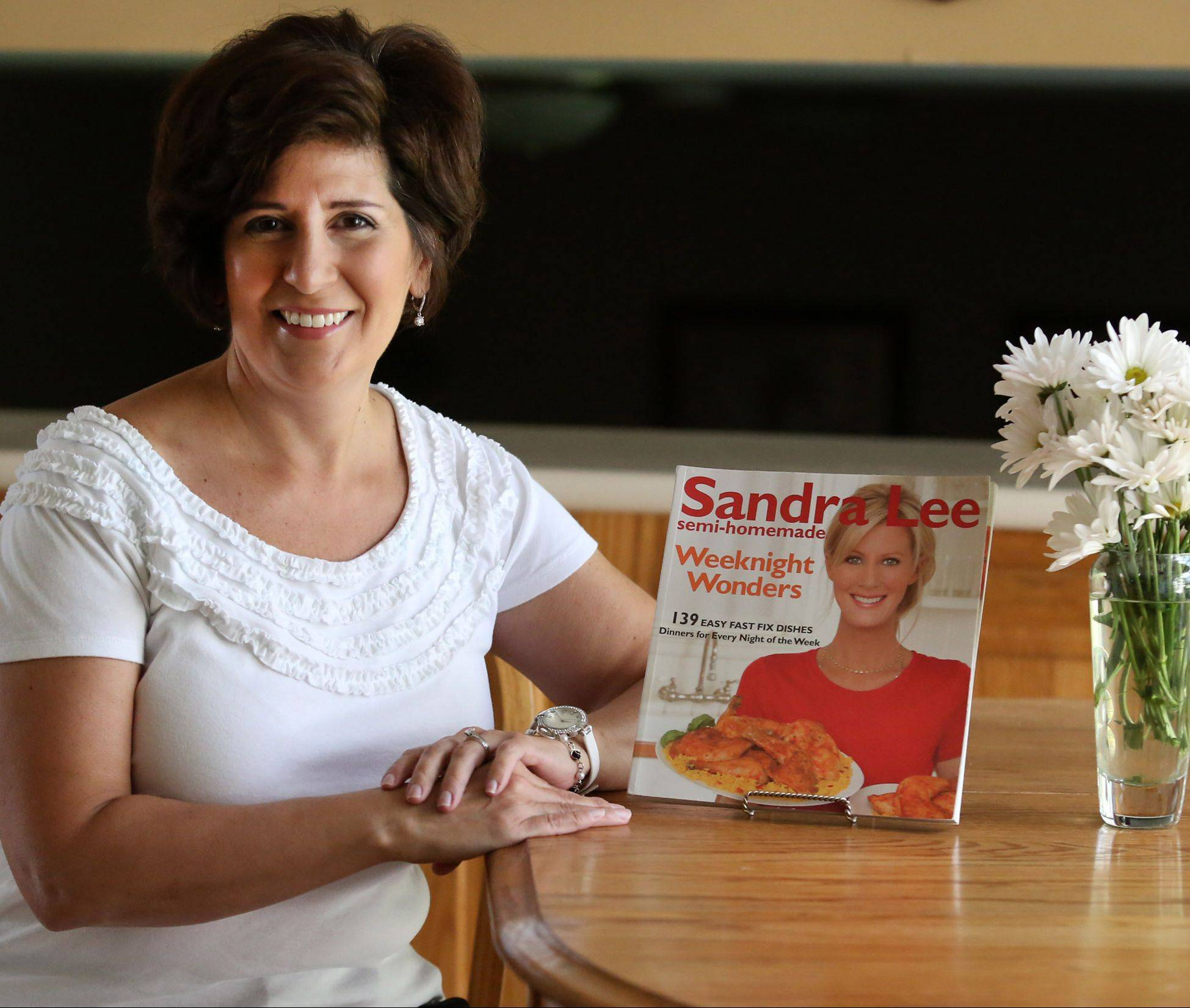 "Nancy Smearman of Palatine is one of 16 contestants in the Cook of the Week Challenge. She looks to ""Semi-Homemade"" chef Sandra Lee's cook books for recipes and tips."