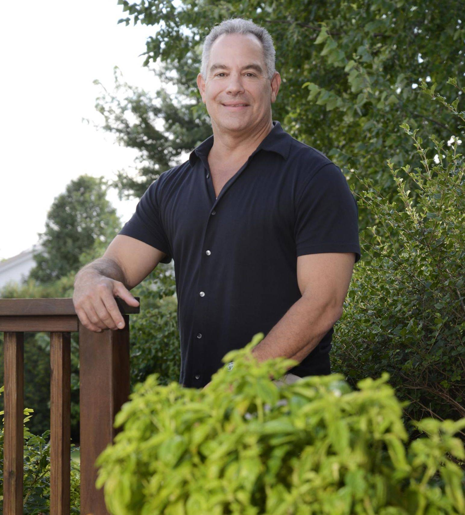 Cook of the Week Challenge competitor Mike Baron, of South Elgin, with basil he grows in his backyard.