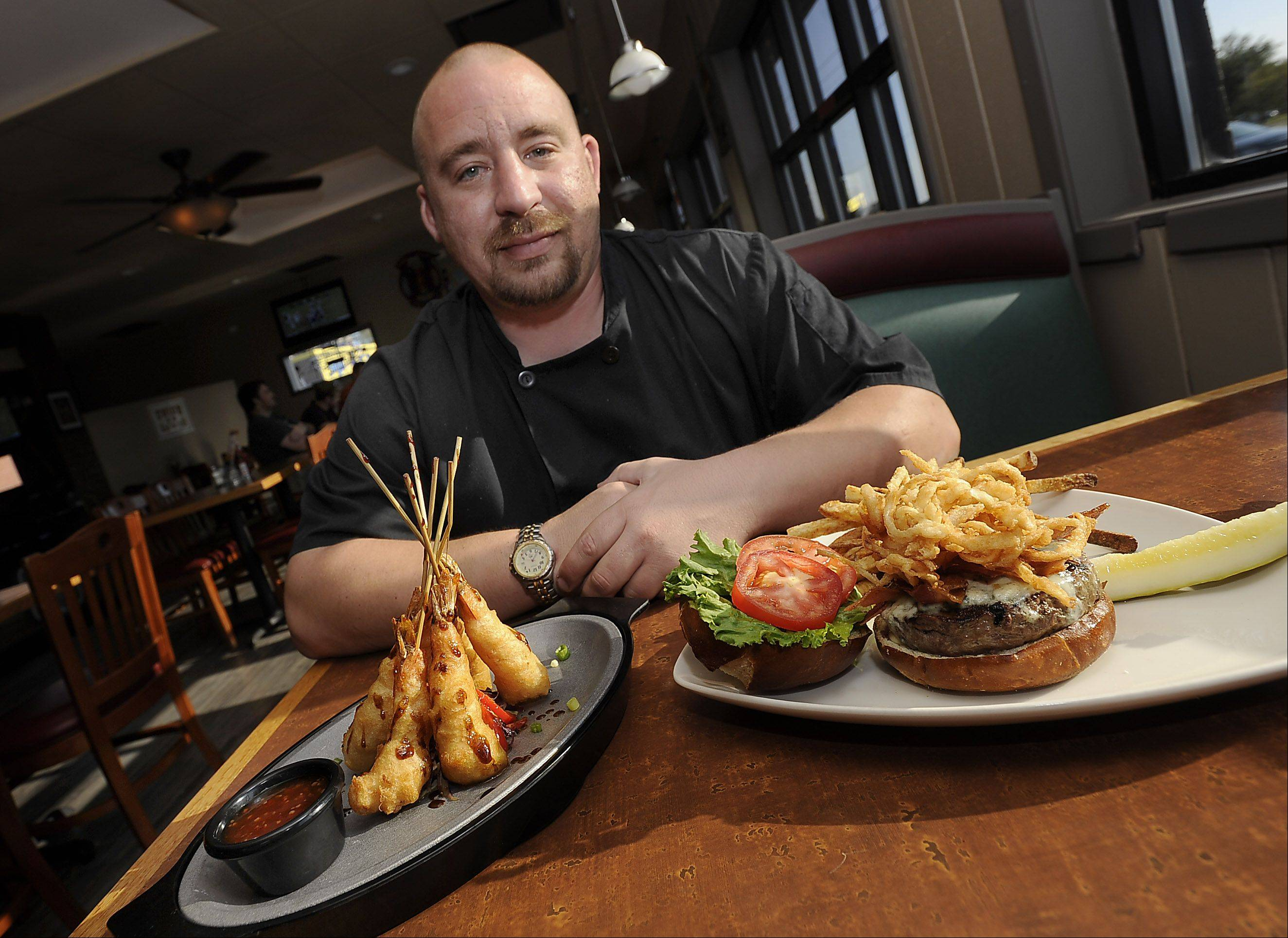 Executive chef Mark Claxton serves up a bacon blue burger and Tokyo shrimp at the Union Ale House in Prospect Heights.
