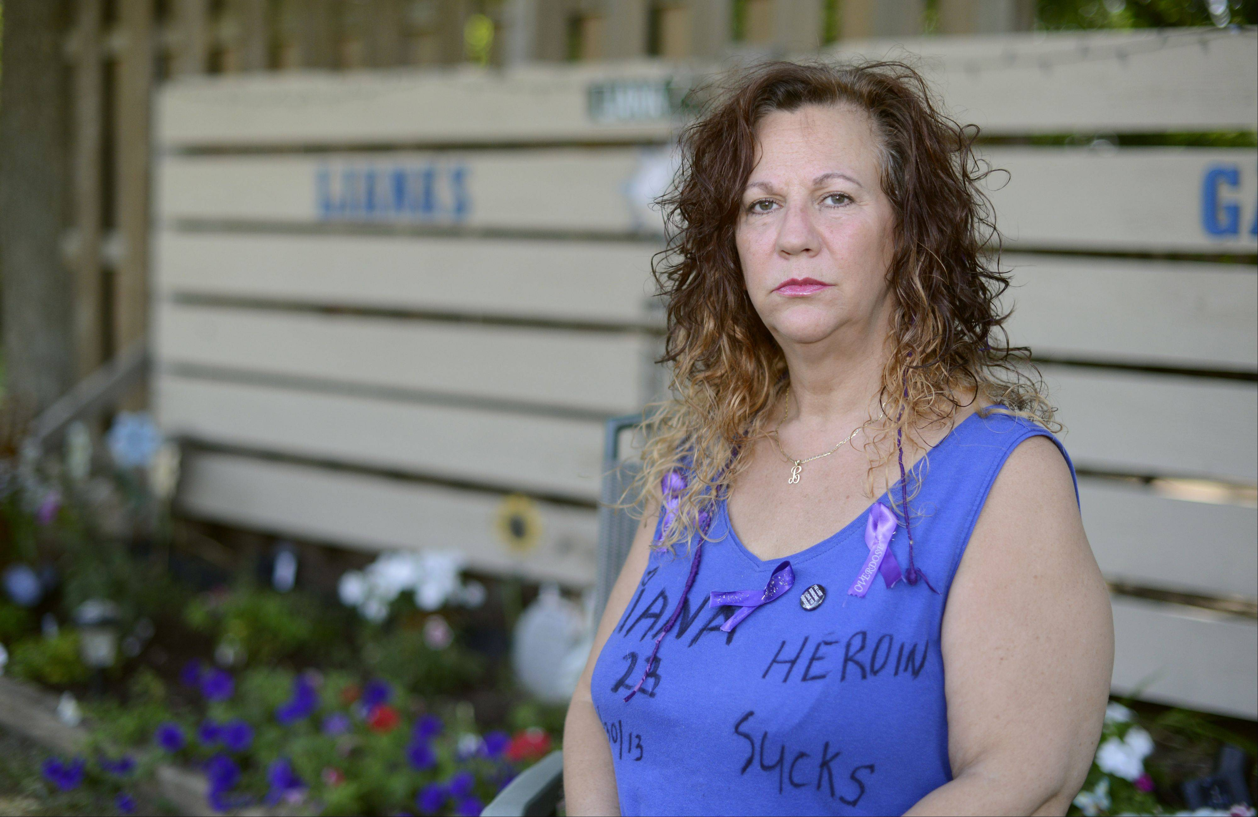 Tanya Childs of Elgin is organizing a rally Saturday in Elgin for International Drug Overdose Awareness Day. Childs lost her 23-year-old daughter, Liana, to what she is sure was a heroin overdose in April. Her front yard now has a garden in Liana's memory, to which people continually add flowers, plants and decorations.