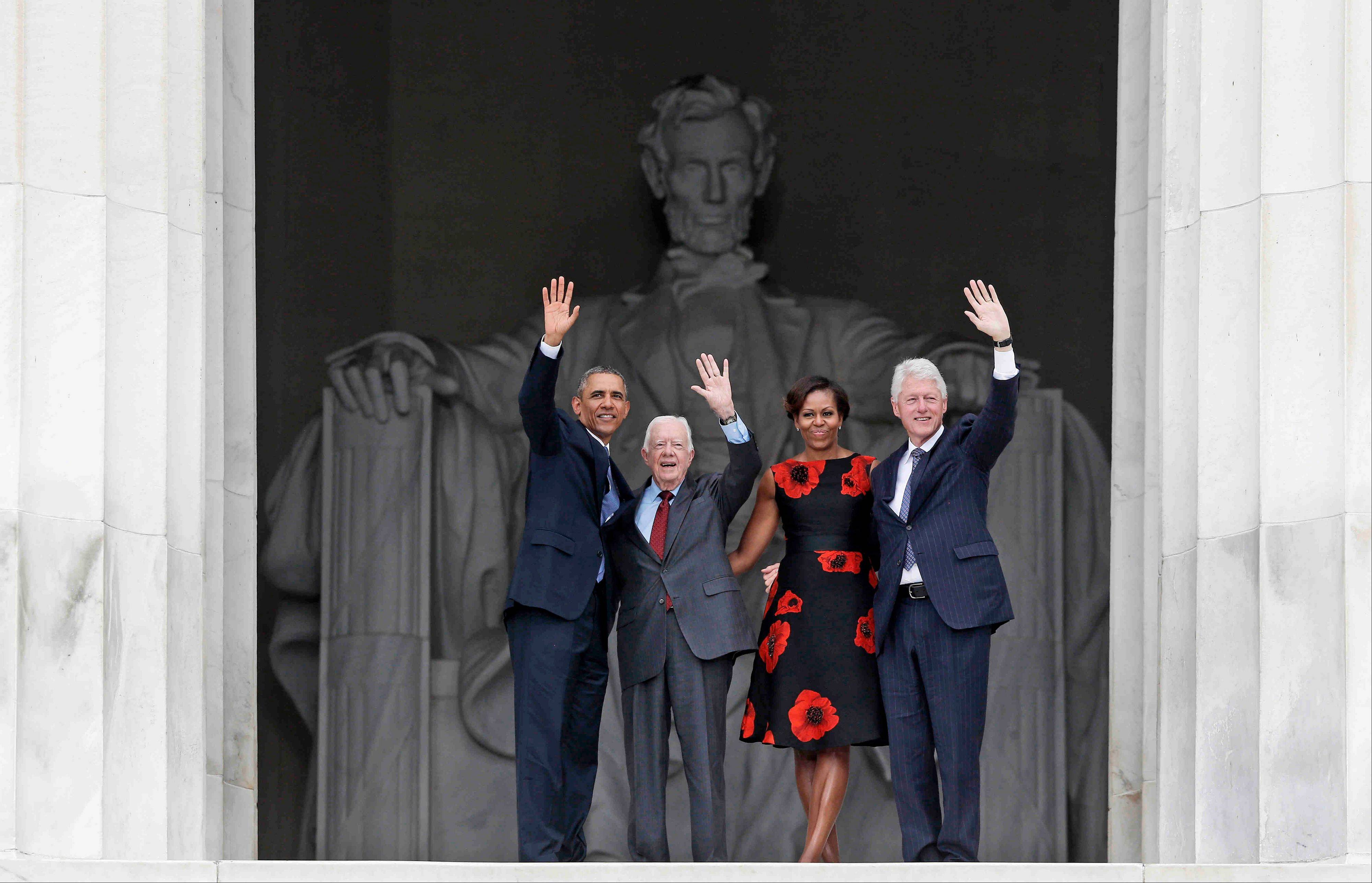 President Barack Obama, first lady Michelle Obama, former President Jimmy Carter and former President Bill Clinton wave as they leave.