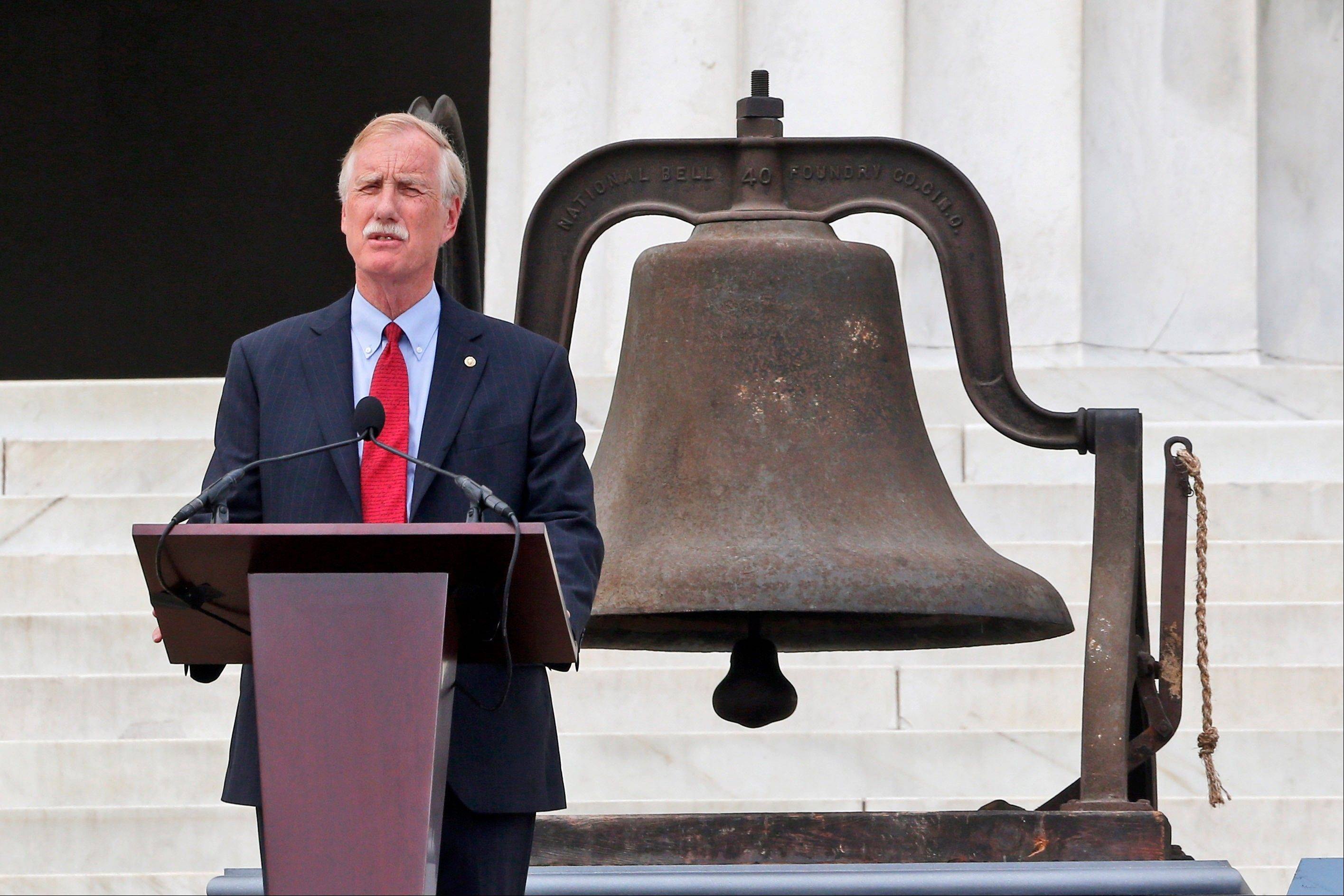 Sen. Angus King, I-Maine, speaks in front of the Lincoln Memorial in Washington. The bell at rear rang at the 16th St Baptist Church in Birmingham, Ala. which was bombed 18 days after the March On Washington killing four young girls.