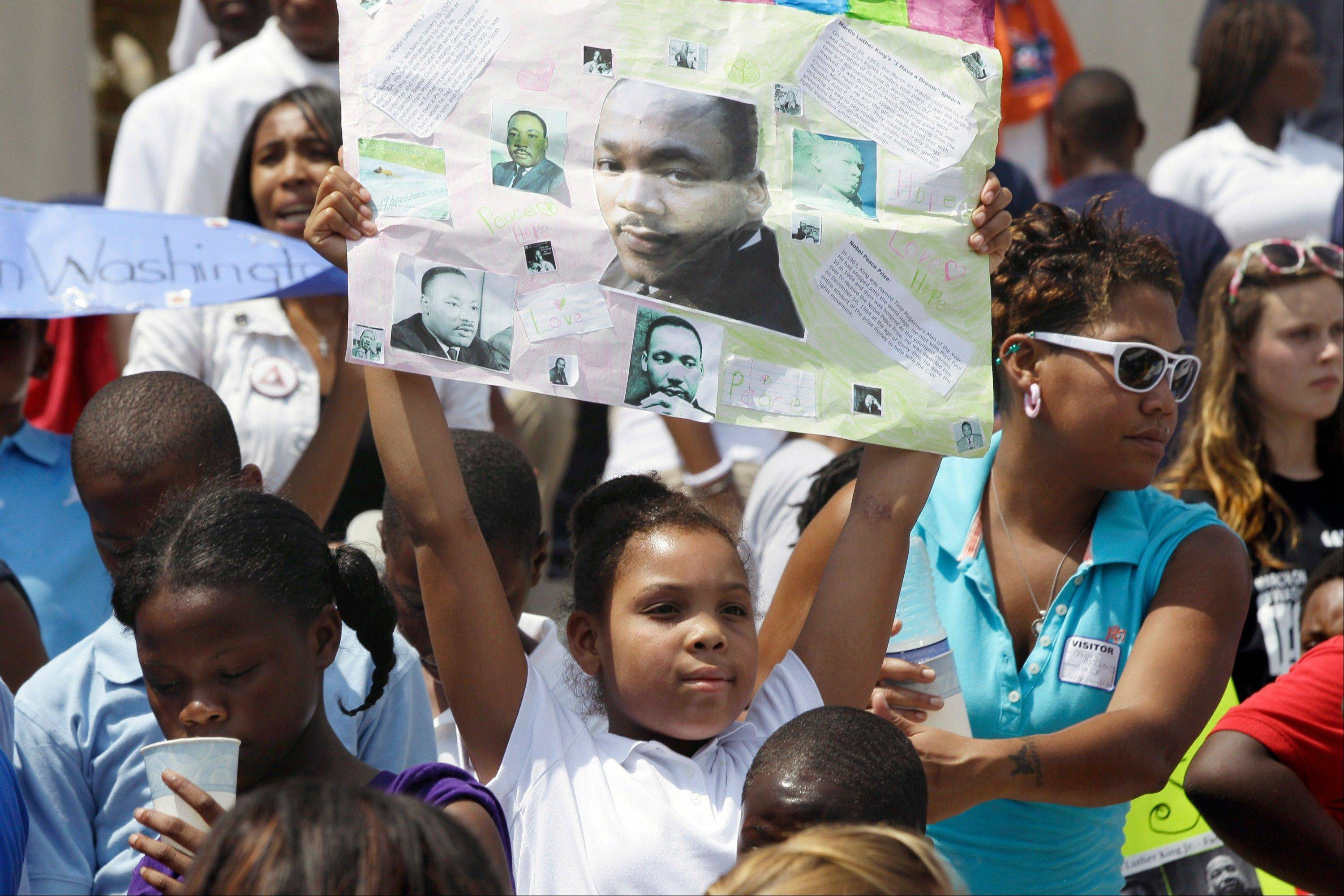 Nyla Washington, 10, of Little Rock, Ark., holds a poster she made showing Rev. Martin Luther King at the Arkansas state Capitol in Little Rock, Ark., Wednesday, Aug. 28, 2013. Hundreds gathered at the Capitol to mark the 50th anniversary of the March on Washington.