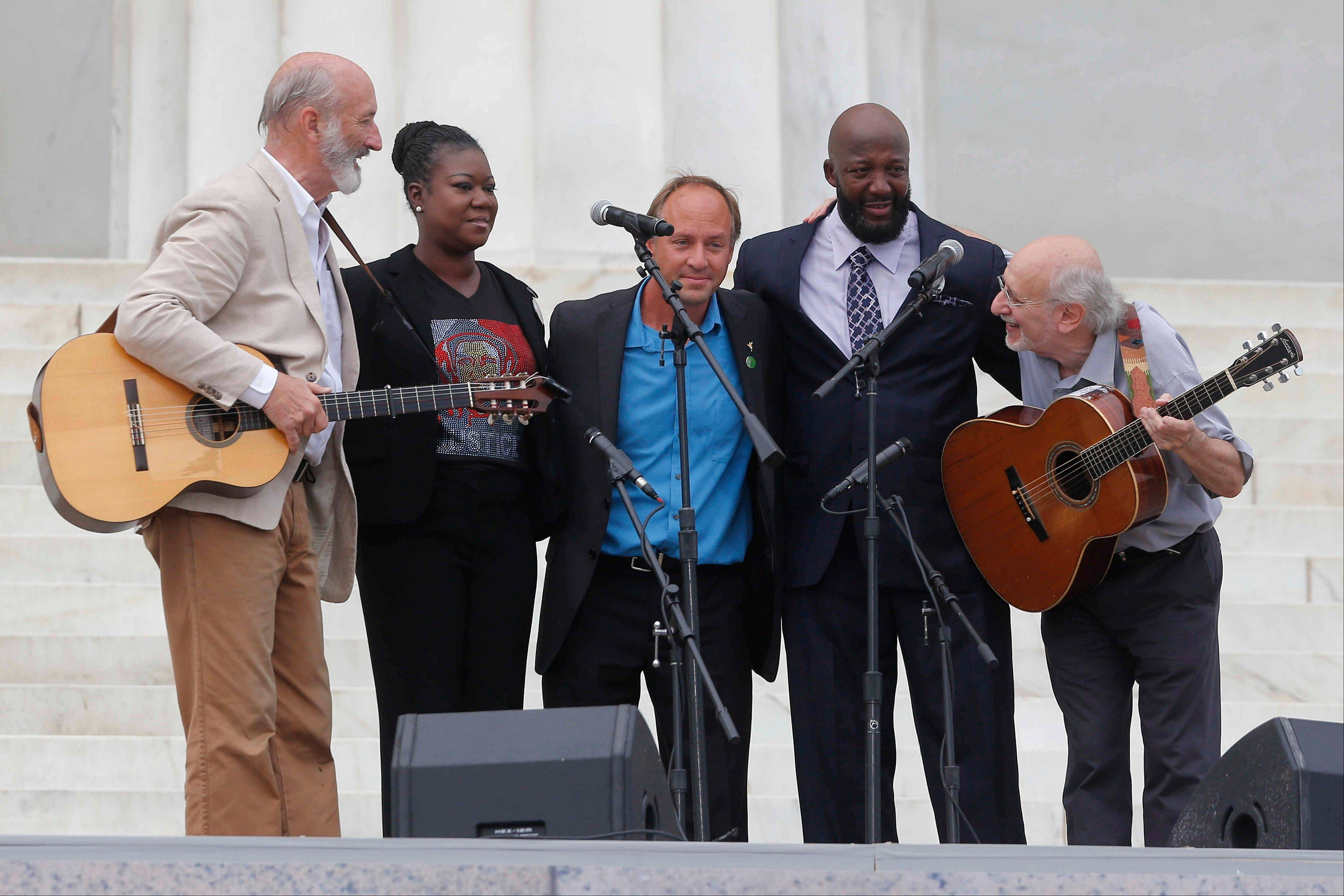 With Trayvon Martin's parents, Sybrina Fulton, and Tracy Martin, and Mark Barden, father of Sandy Hook Elementary School shooting victim Daniel Barden, Peter Yarrow, left, and Paul Stookey, right, of the folk trio Peter, Paul and Mary, perform at the 50th Anniversary of the March on Washington .