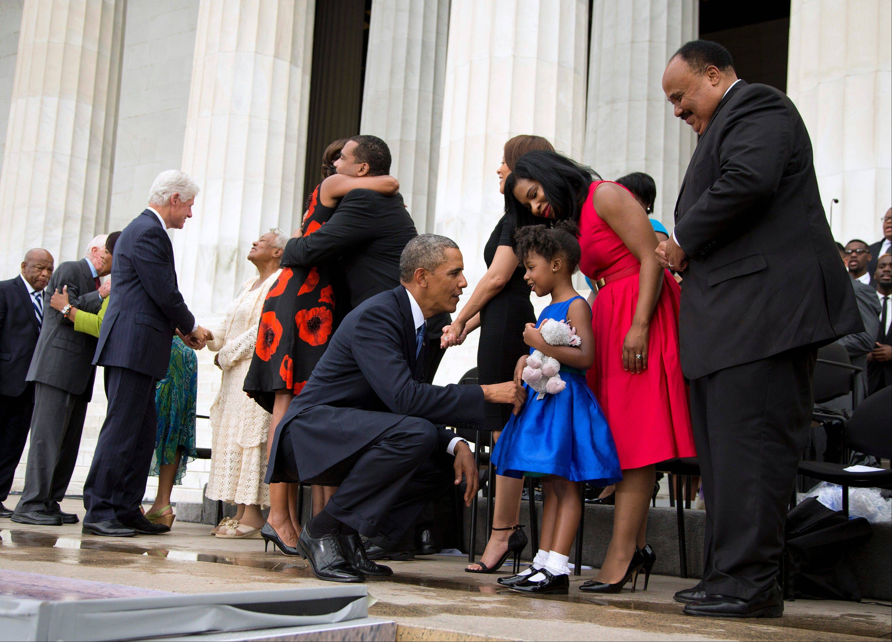 President Barack Obama talks with Yolanda Renee King, 5, granddaughter of Martin Luther King Jr., her mother Arndrea Waters, and Martin Luther King III, right, after speaking.