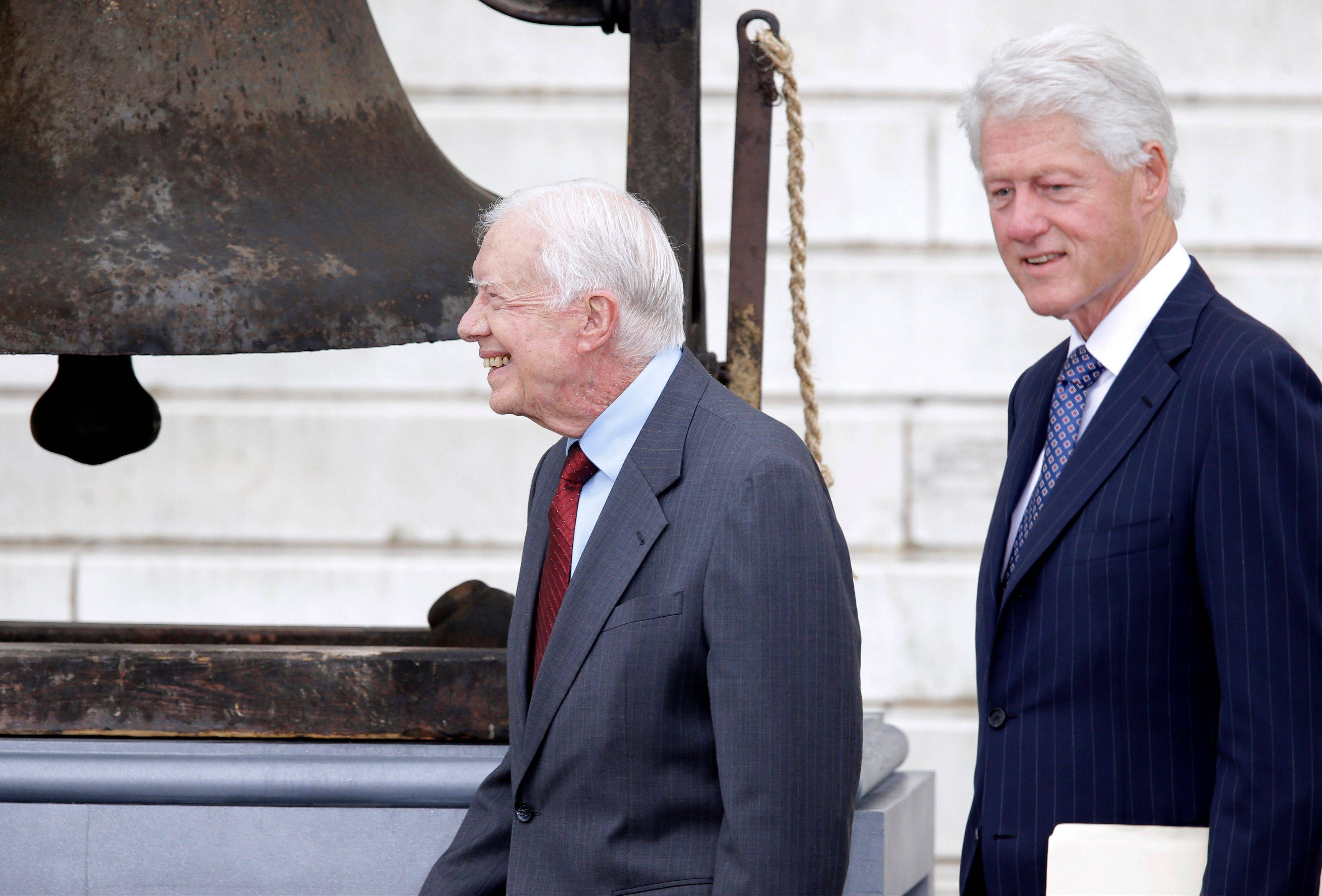 Former Presidents Jimmy Carter and Bill Clinton arrive at the Let Freedom Ring ceremony.
