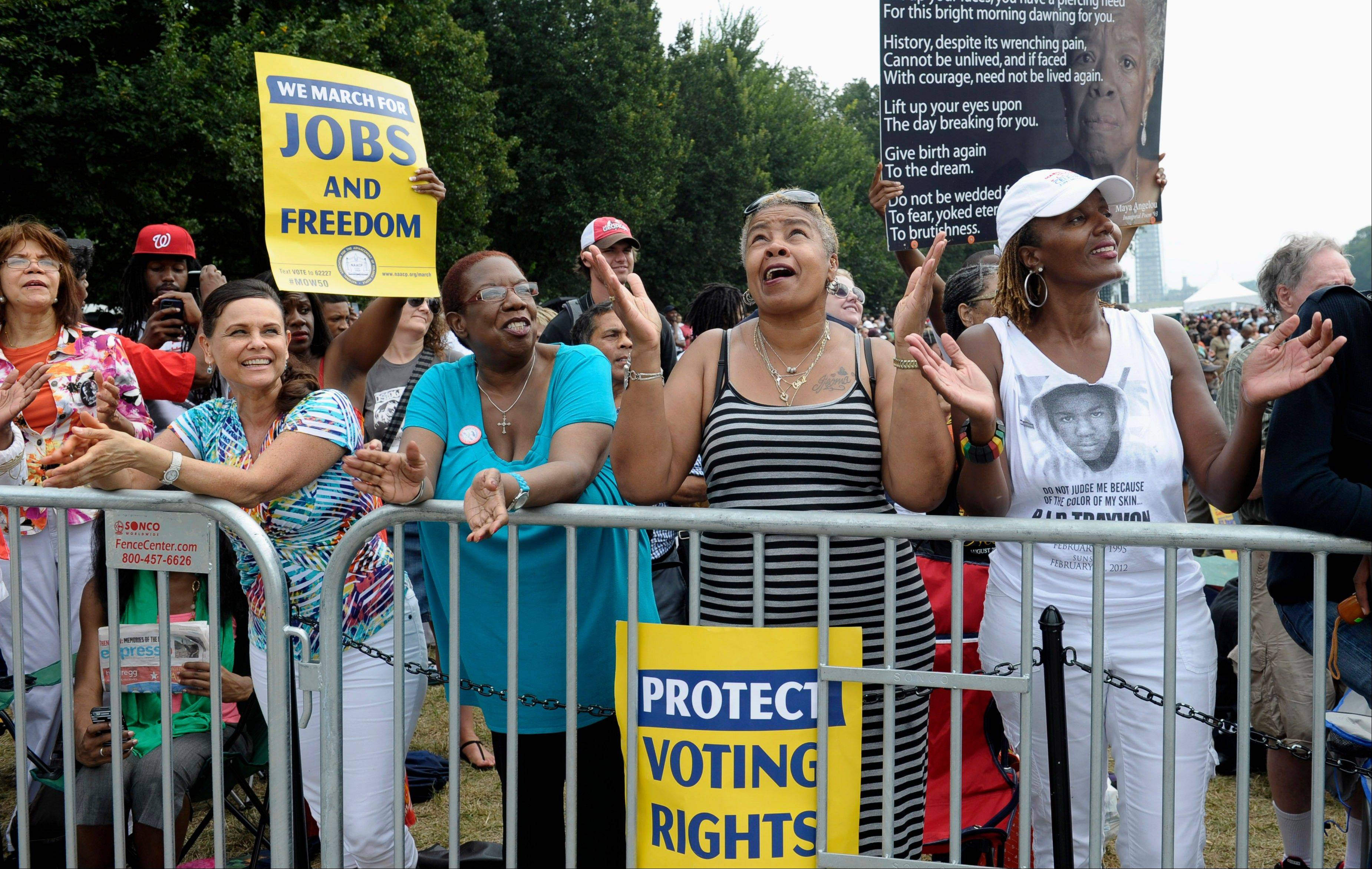 Allie Santiago of Houston, left, Brenda Reid of Bronx, N.Y., second from left, Caril Howard of North Chesterville, Va., and Jo Ann White Thompson of Goldsboro, N.C., listen to a musical performance.