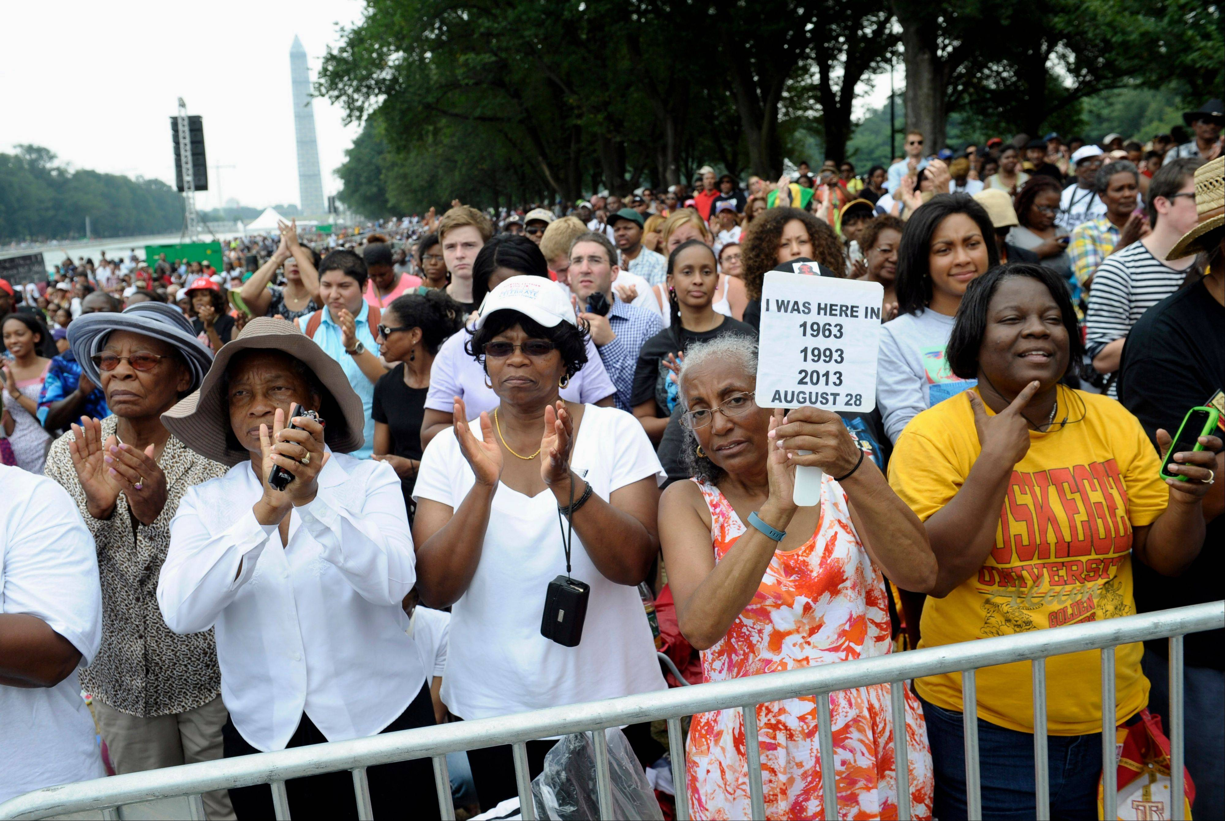Three women who attended previous Marches on Washington, from left, Armanda Hawkins of Memphis, Vera Moore of Washington, and Betty Waller Gray of Richmond, Va., (holding sign) listen to the speakers.