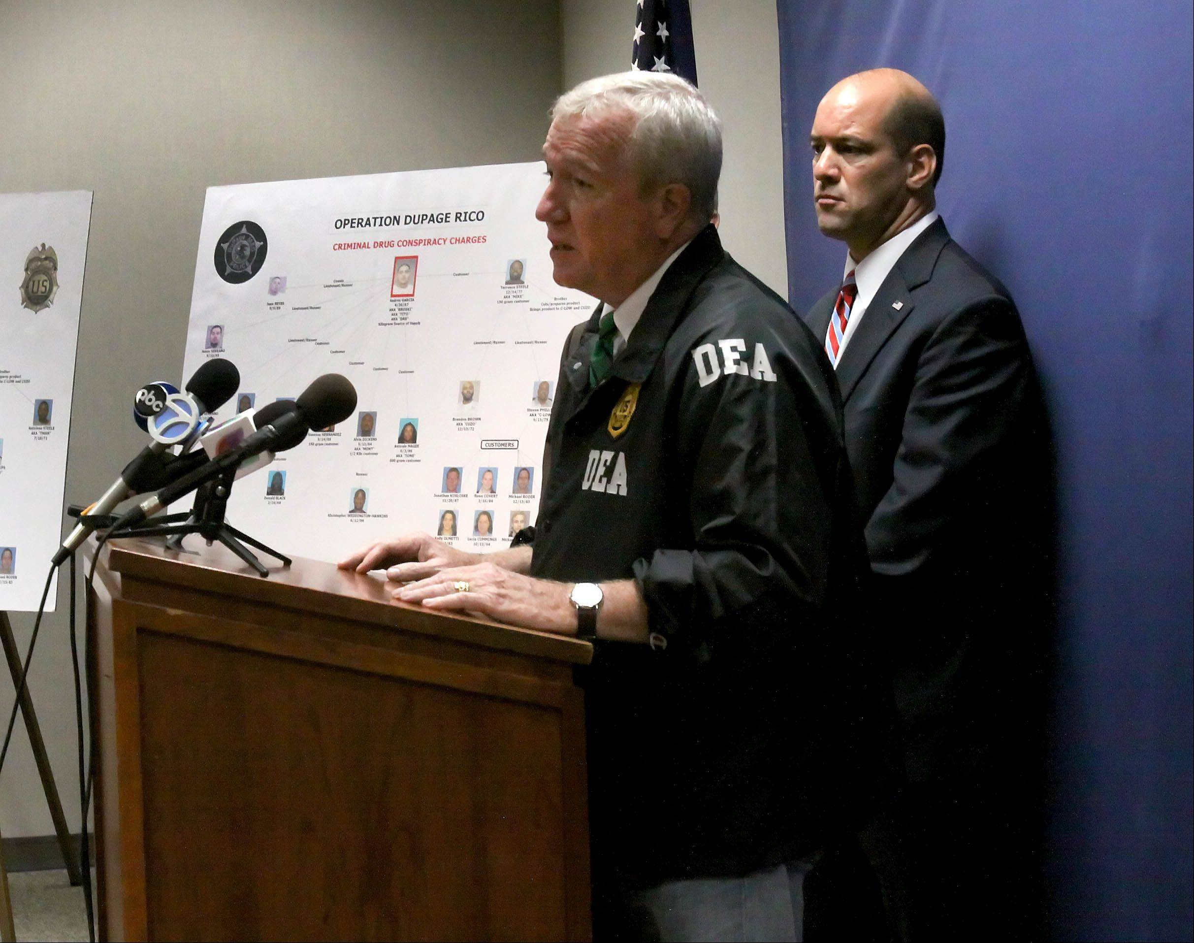 DEA Special Agent Jack Riley, left, and DuPage County State's Attorney Robert Berlin announce heroin charges against 31 people.