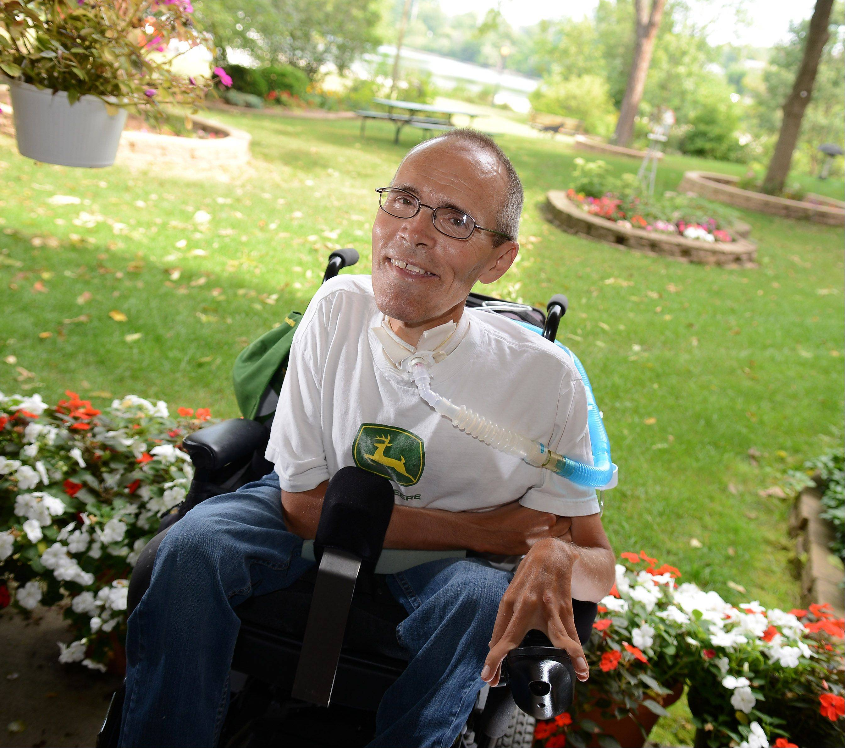 "Robin Hewitt of Batavia, who has Duchenne muscular dystrophy, recently turned 50. Many people with his disease don't live much past 20. ""My days are pretty full, and I enjoy the time I get to spend with my friends,"" Hewitt says."