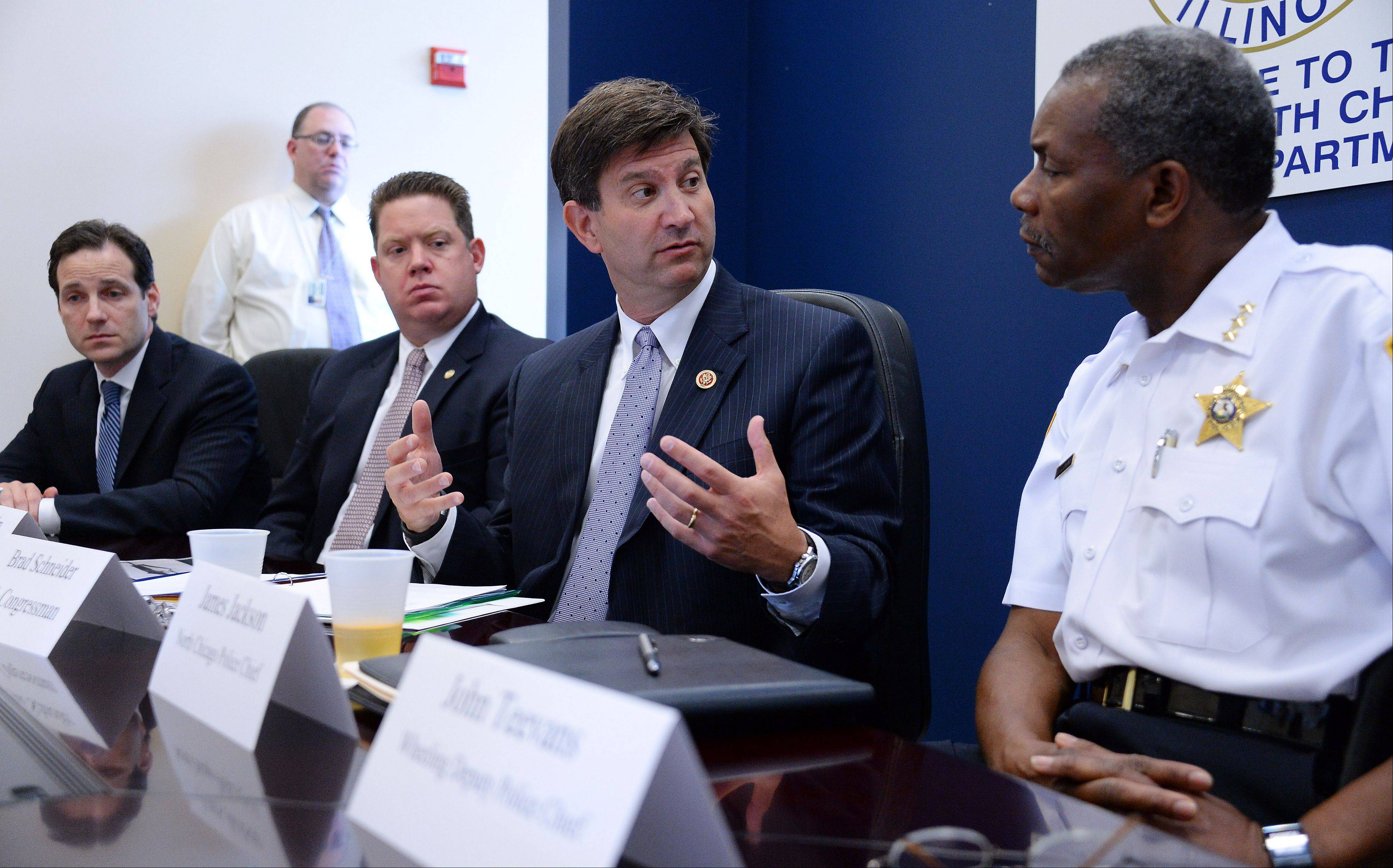 U.S. 10th District congressman Brad Schneider talks with North Chicago Police Chief James Jackson and other area police chiefs about ways to combat gun violence on local, federal and state levels in North Chicago on Wednesday.