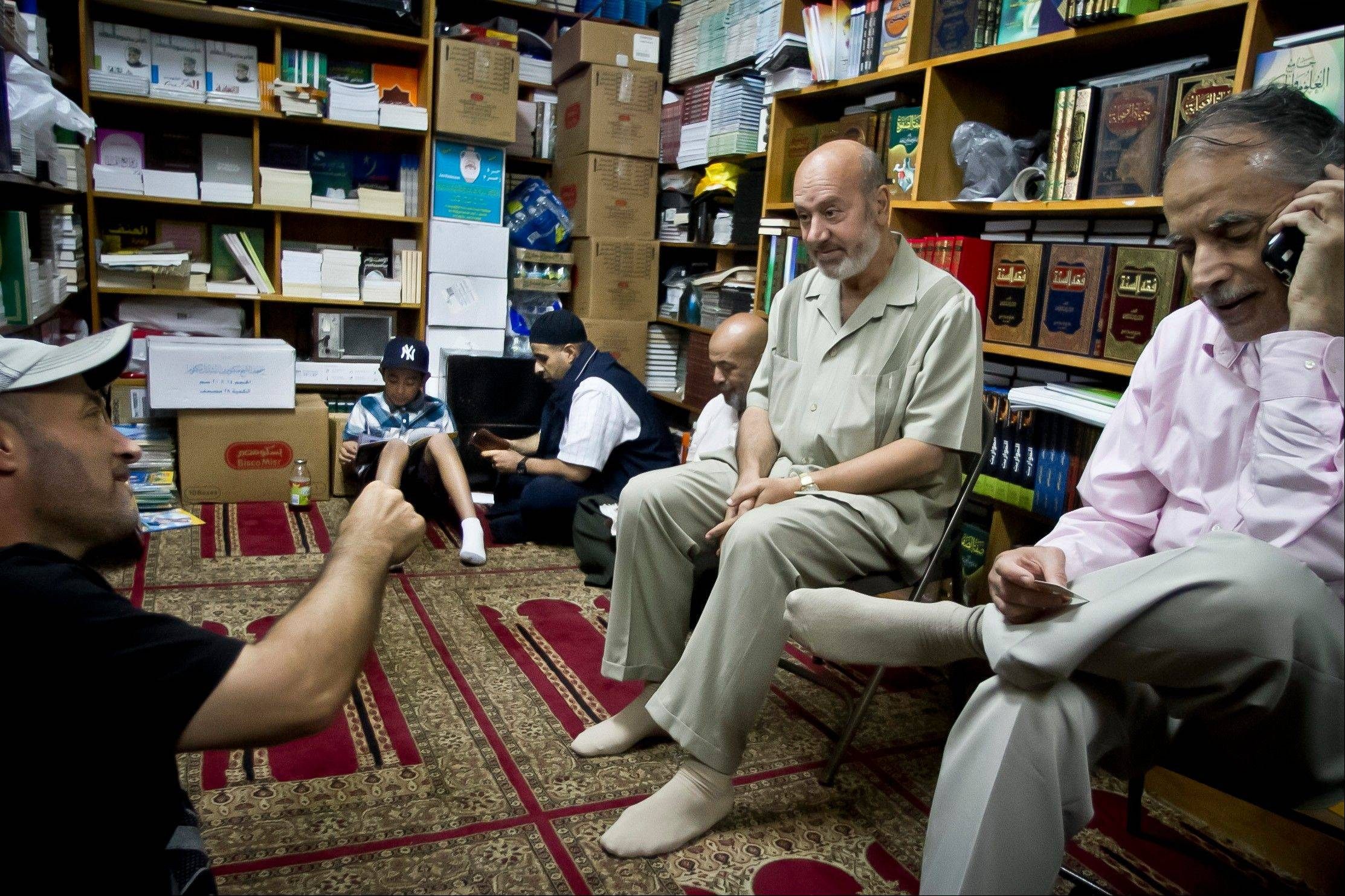 Zein Rimawi, 59, second from right, a leader and founder of the Islamic Society of Bay Ridge and mosque, meet with members in his office before a Jumu'ah prayer service at the mosque on Friday, Aug. 16, 2013 in Brooklyn, N.Y. The NYPD targeted his mosque as a part of a terrorism enterprise investigation beginning in 2003, spying on it for years. The mosque has never been charged as part of a terrorism conspiracy.