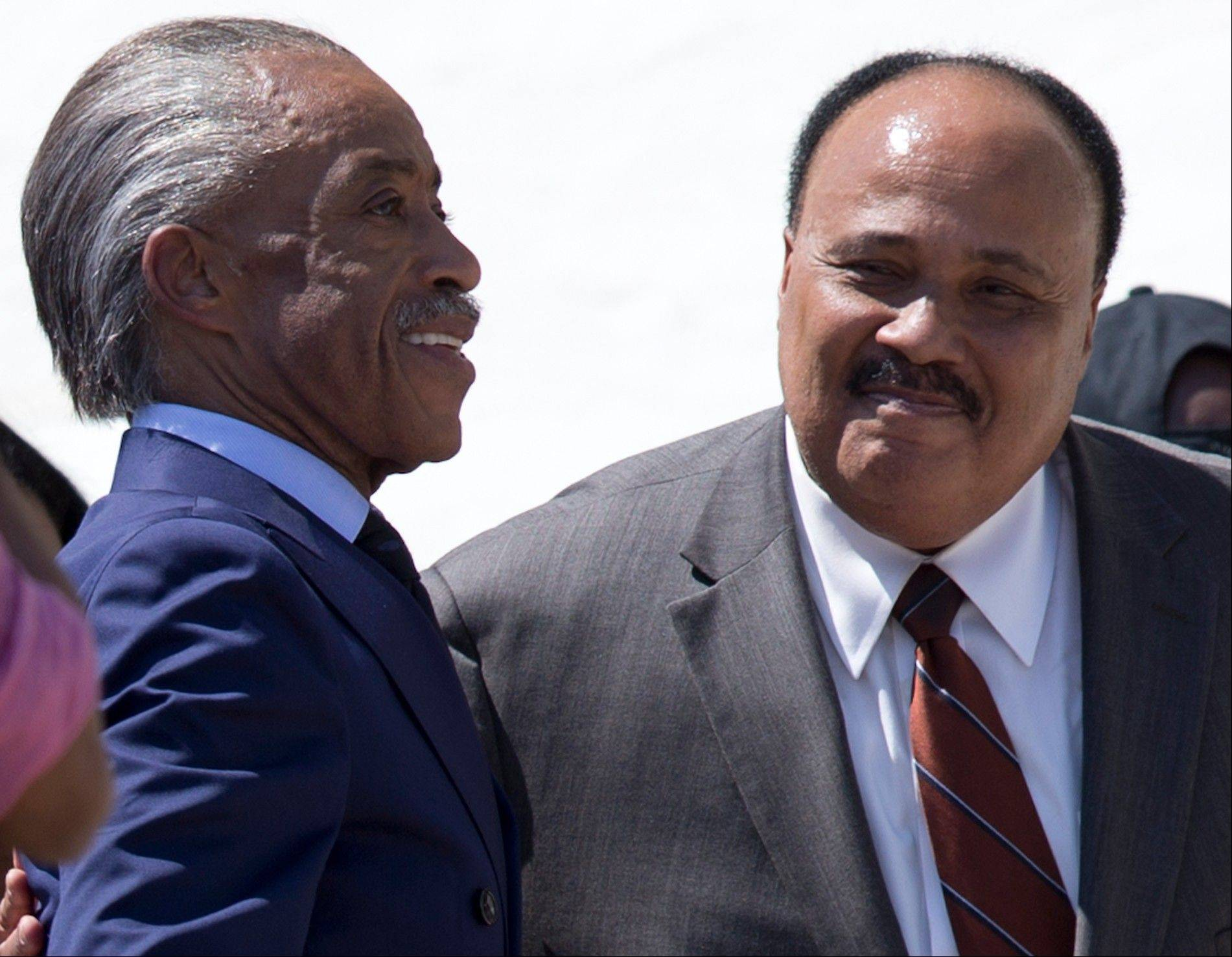 Rev. Al Sharpton, left, and Martin Luther King III stand together during an event to commemorate the 50th anniversary of the 1963 March on Washington at the Lincoln Memorial, Saturday, Aug. 24, 2013, in Washington. The eldest son of Dr. Martin Luther King Jr. says blacks can rightfully celebrate his father's life and work with pride, but much more must be accomplished.