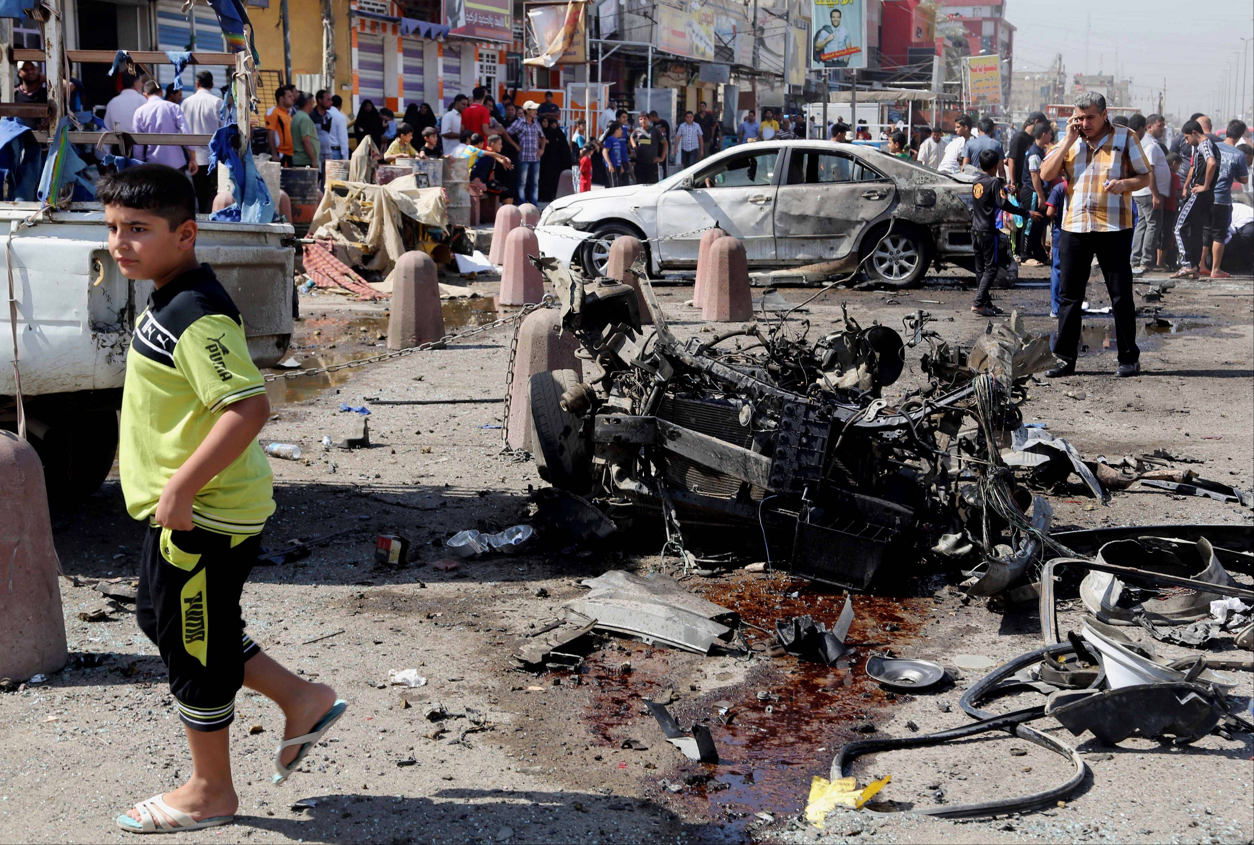 A coordinated wave of bombings tore through Shiite Muslim areas in and around the Iraqi capital early Wednesday, killing scores and wounding many more, officials said. The blasts, which came in quick succession, targeted residents out shopping and on their way to work.