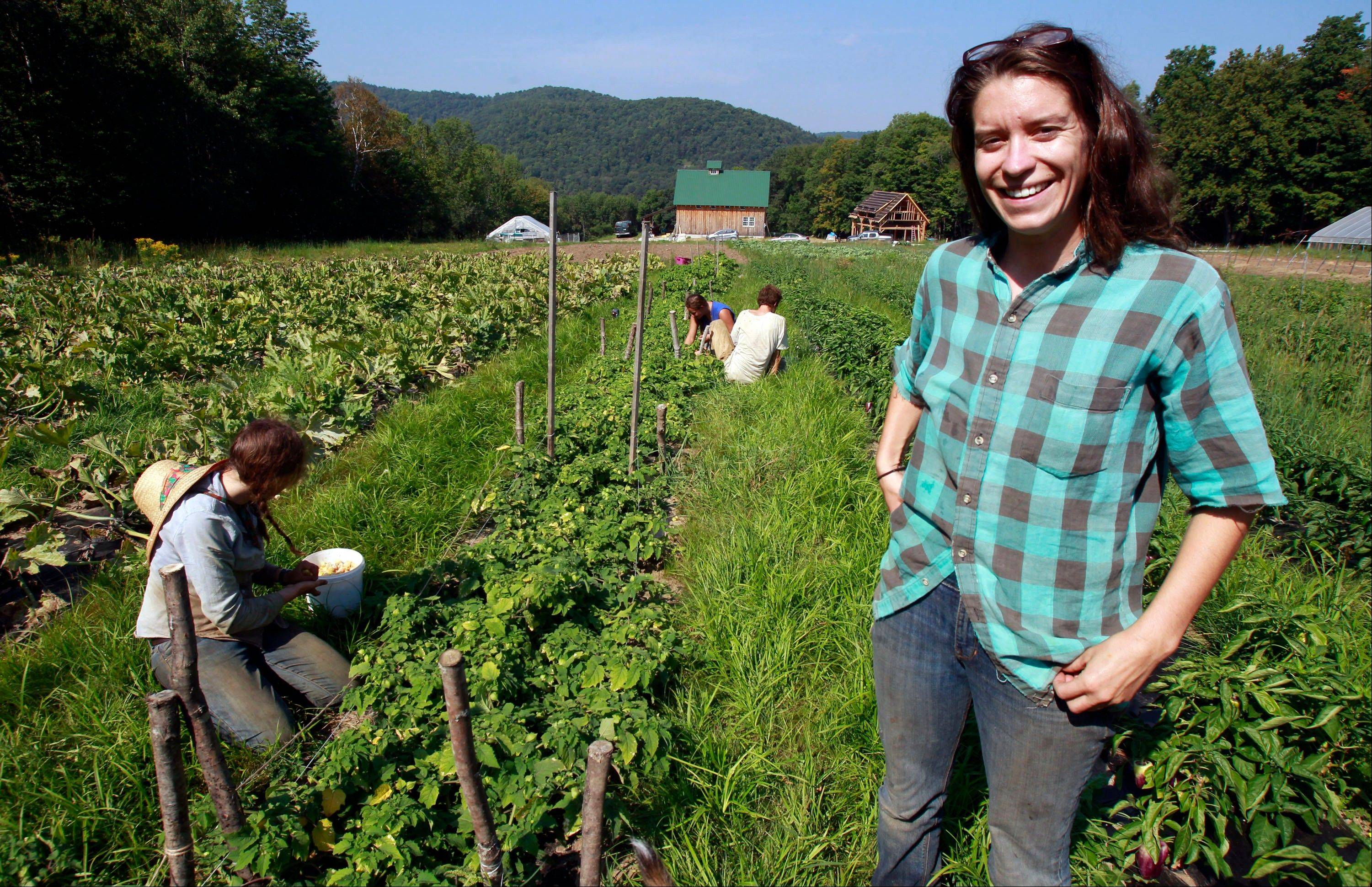 Kara Fitzgerald stands at her new farm location in Shrewsbury, Vt. Two years after Irene washed away 10 acres of summer crops and topsoil, Evening Song Farm is back selling produce -- thanks in part to borrowed money and borrowed land. Today she grows crops on a hillside about a mile away.