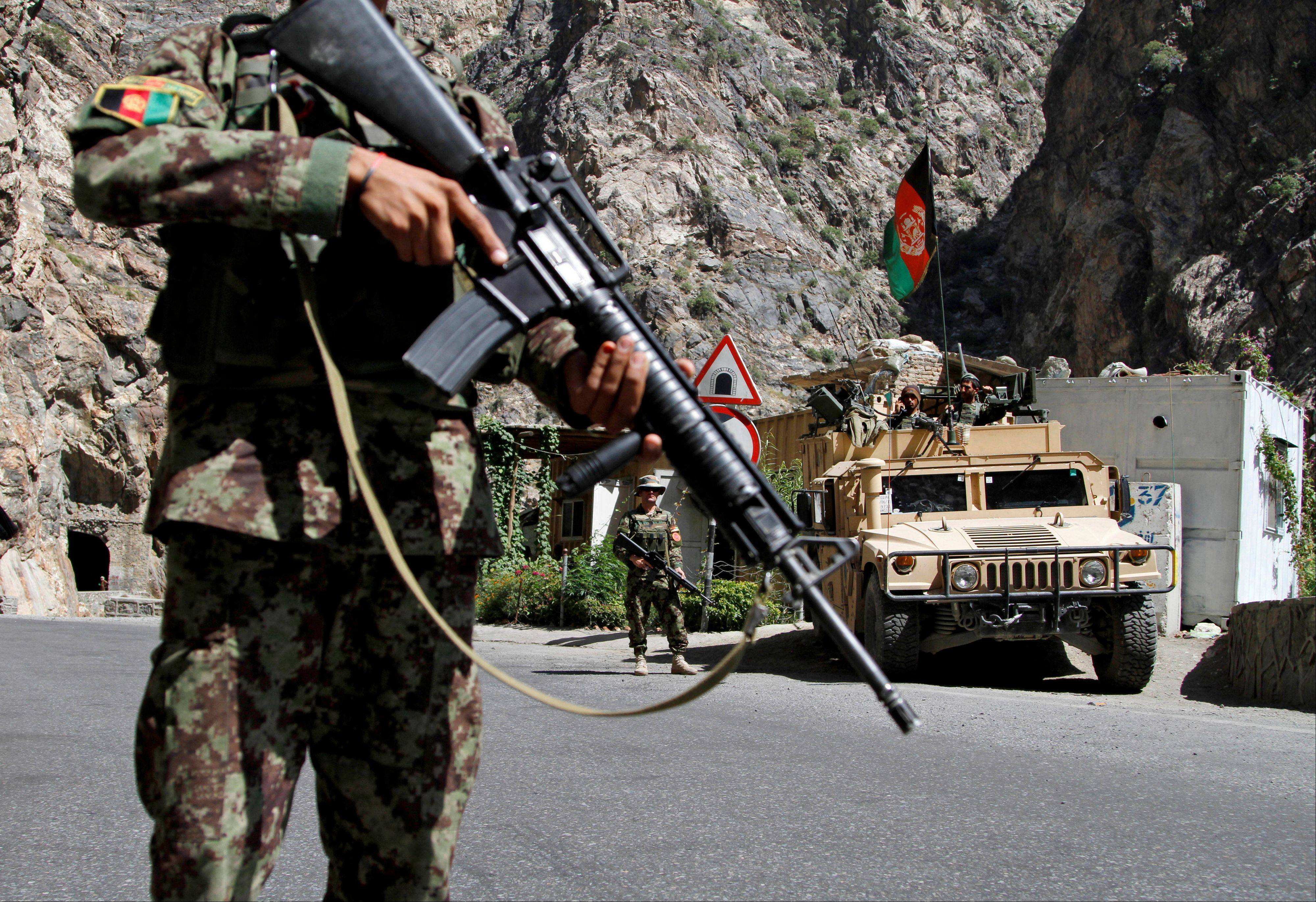 Afghan National Army soldiers stand guard on the outskirts of in Kabul, Afghanistan. Ghazni and neighboring Wardak province have become a hotbed of insurgent activity in the past year, mainly along the main highway which links Kabul to Kandahar in the south and runs through Gulistani�s hometown. Dozens of abductions and killings are reported weekly on the highway, and Afghans are beginning to worry that the nascent Afghan National Security Forces taking over the defense of Afghanistan won't be up to the job.