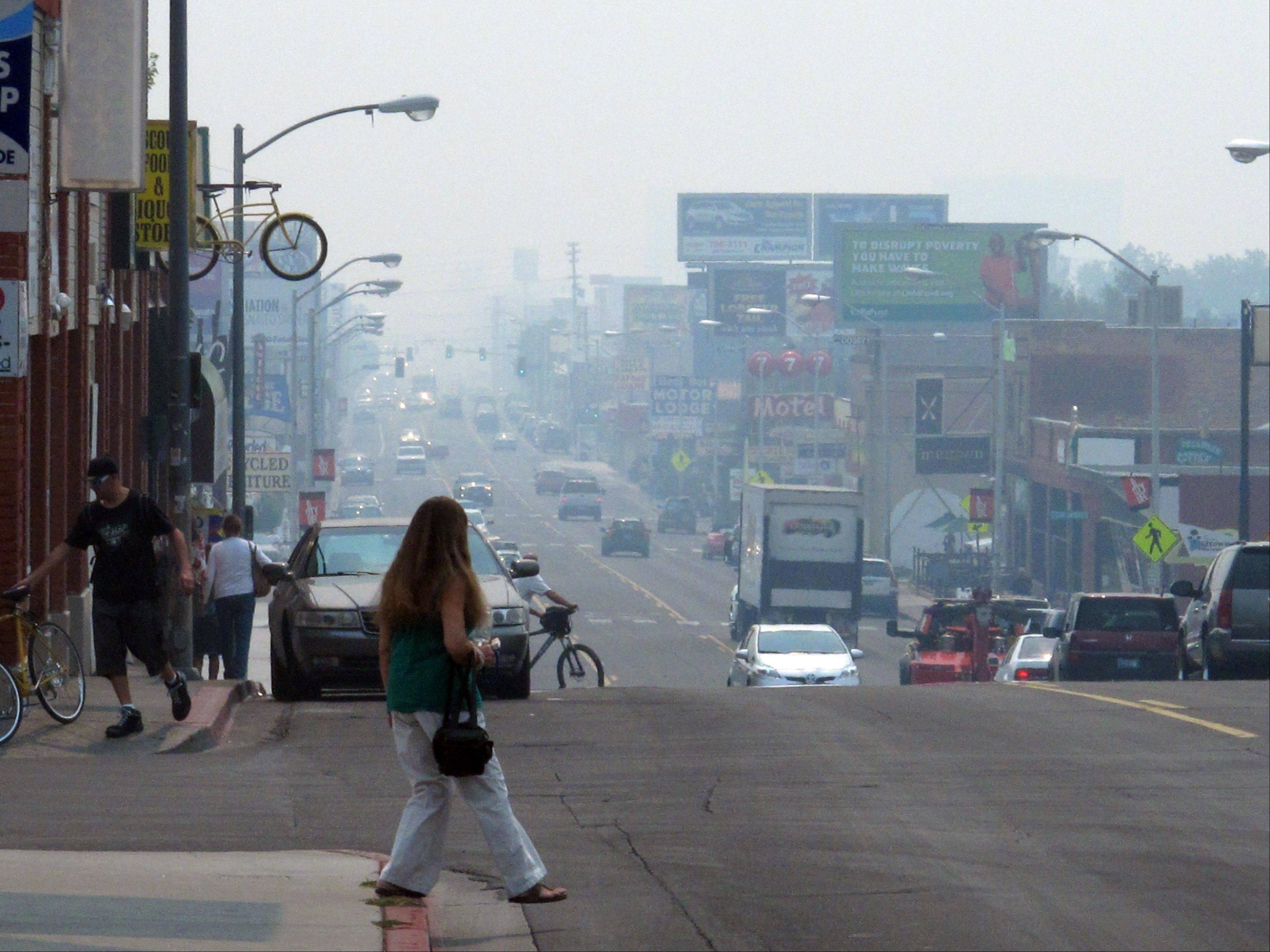 A smoky haze from a huge California wildfire burning more than 150 miles away Tuesday hangs over Virginia Street in Reno, Nev. Most of the Sierra's eastern front from south of Carson City to north of Lake Tahoe has been under an air quality alert for nearly a week.