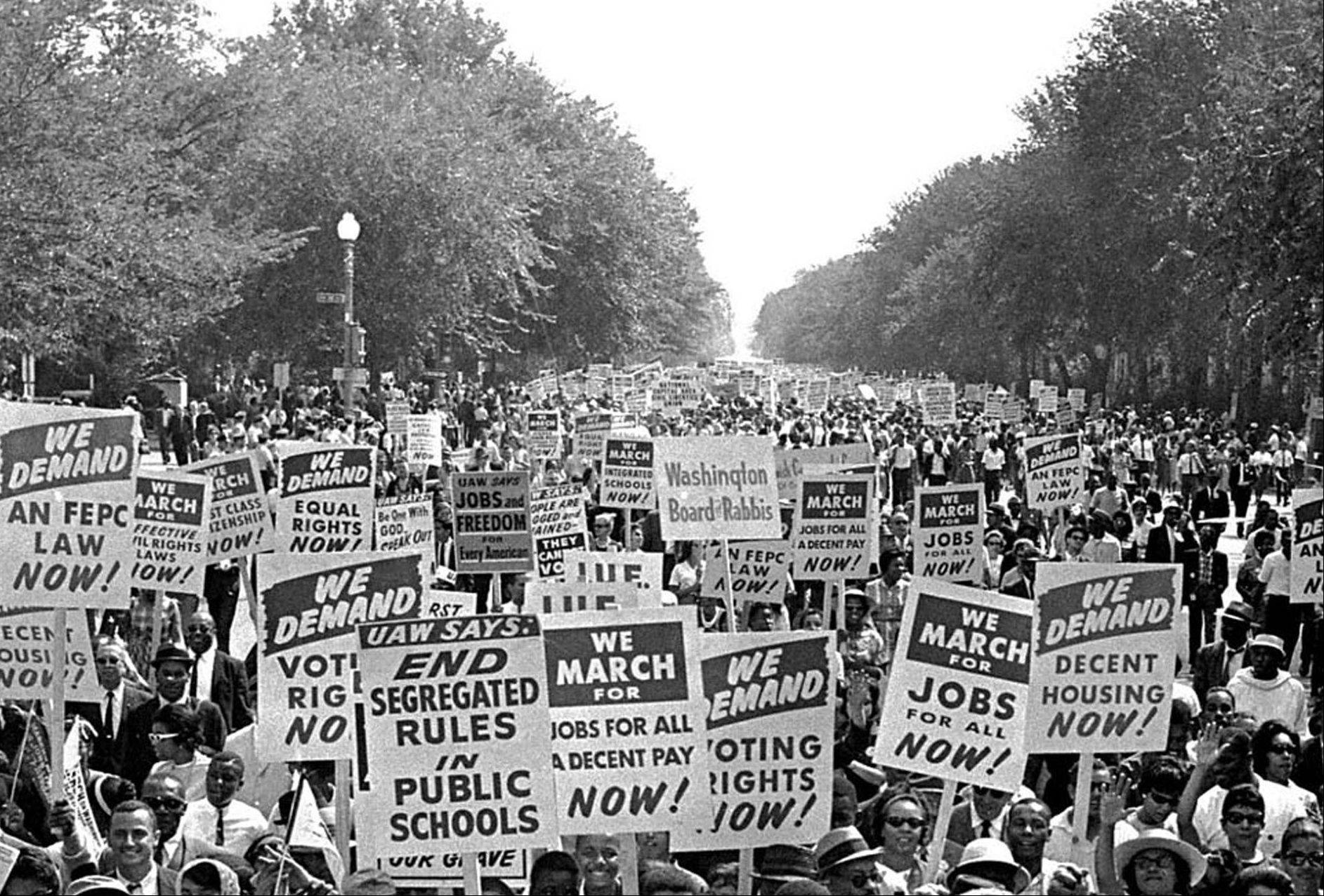 Civil rights protesters march down Constitution Avenue carrying placards during the March on Washington on Aug. 28, 1963.