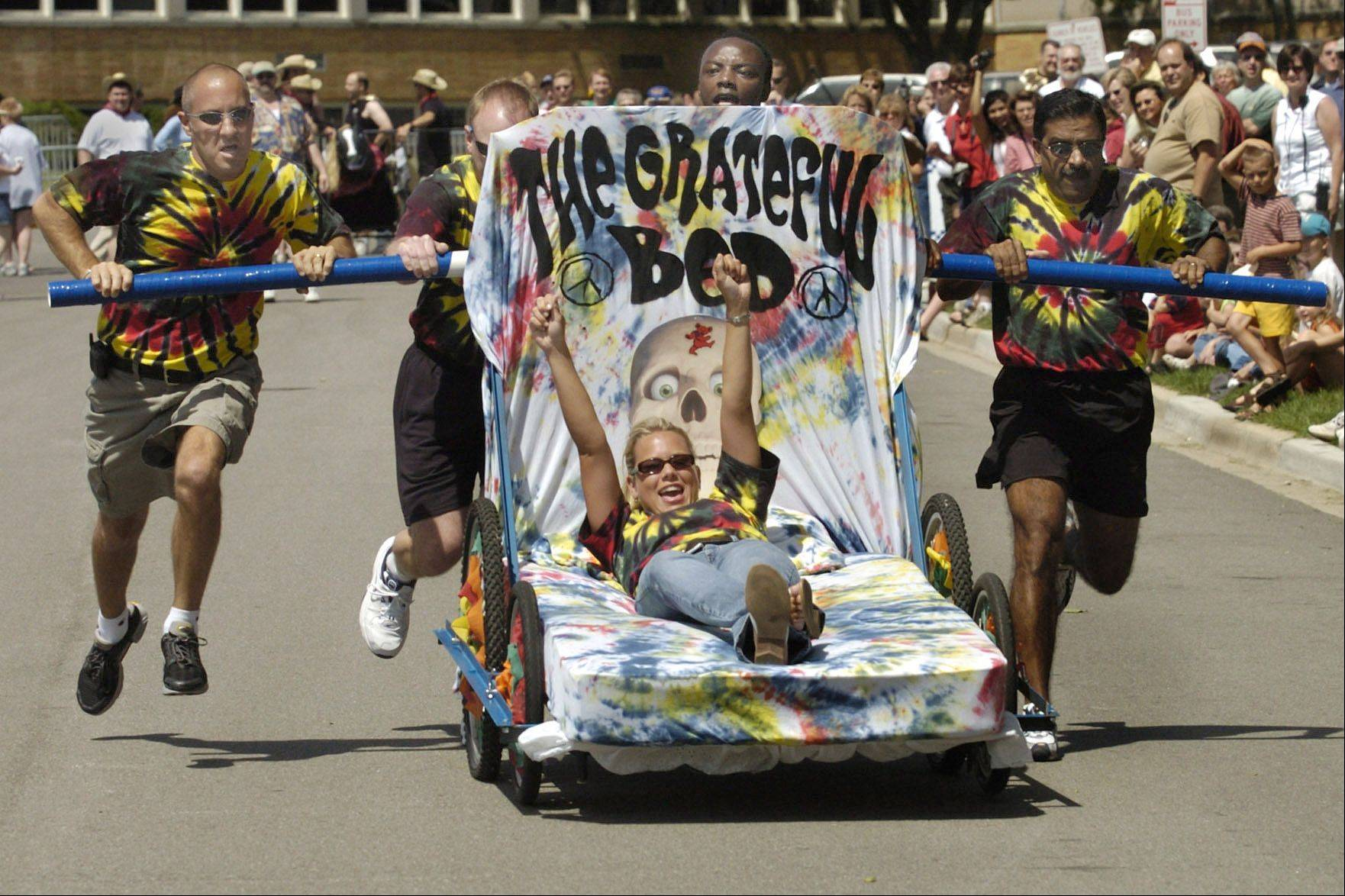 "Teams get creative with the design and themes of their ""beds"" during the annual Last Fling Bed Races in Naperville. The races are set to begin at 11 a.m. Saturday, Aug. 31."