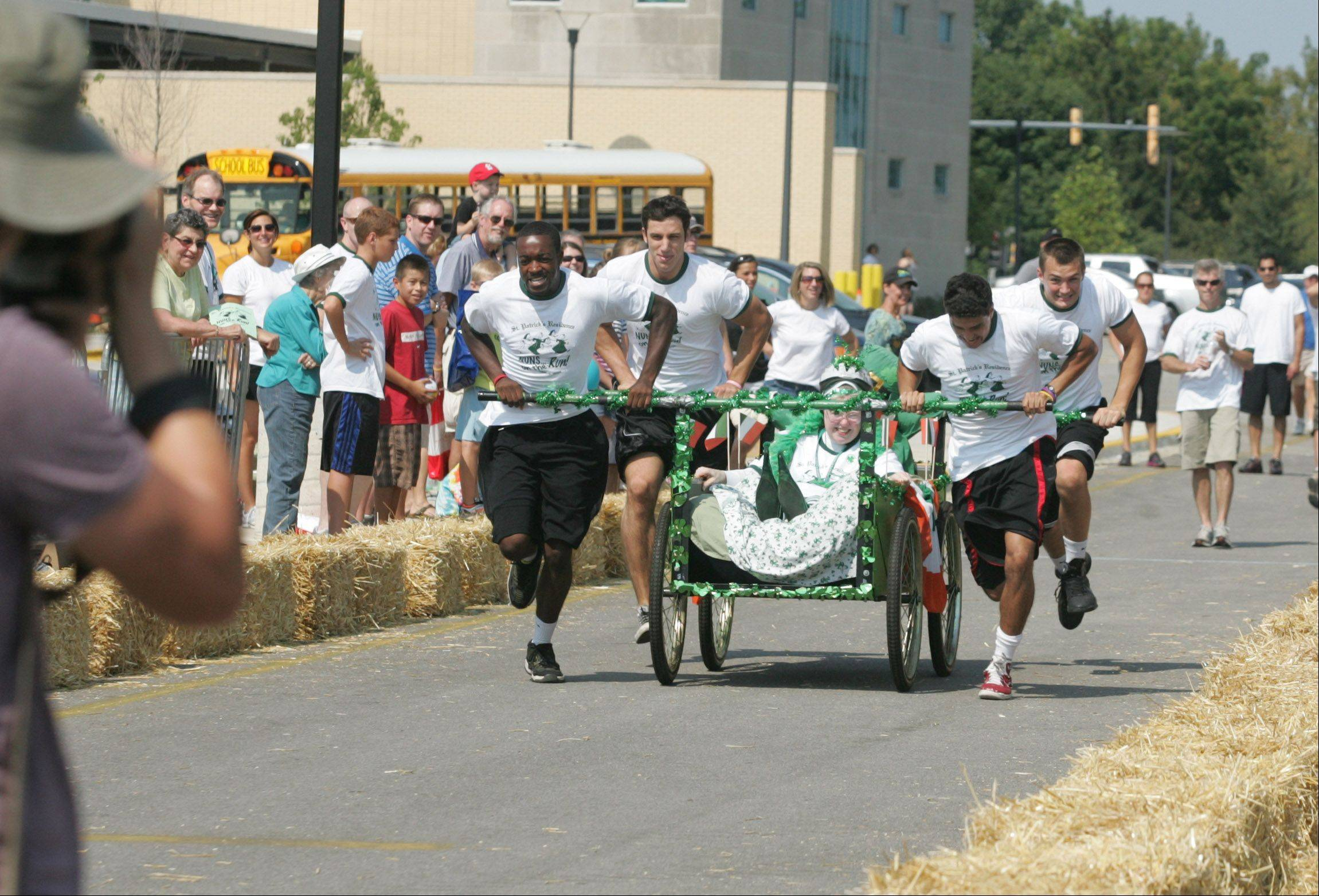 Sister Raphael Schmitz of the St. Patrick's Nuns on the Run team wins the Bed Races at the 2011 Last Fling near downtown Naperville. The church often recruits Benedictine University athletes to propel the bed during the annual event.