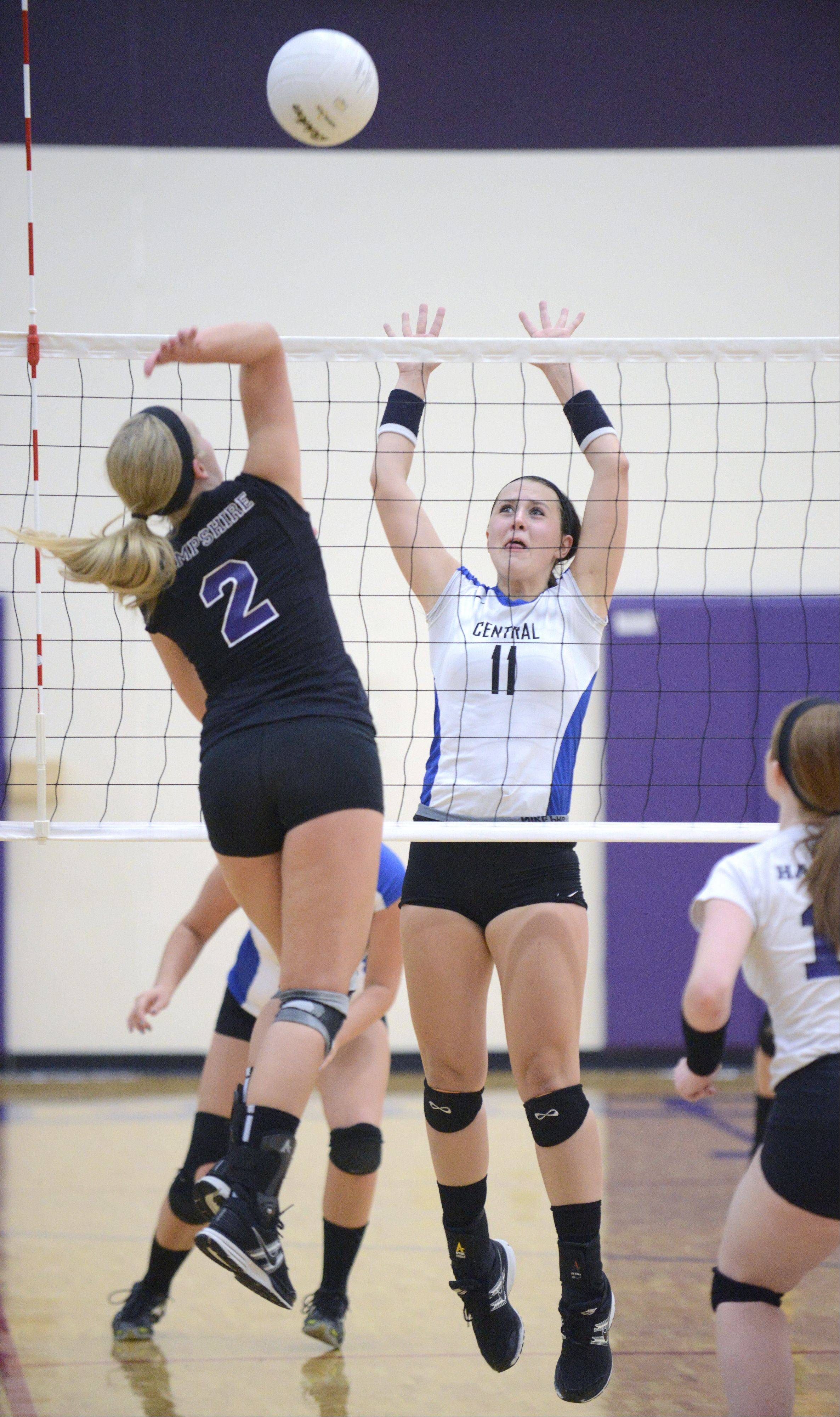 Burlington Central's Caiti Seibert preps to block a spike by Hampshire's Erin Foss in game two on Wednesday, August 28.
