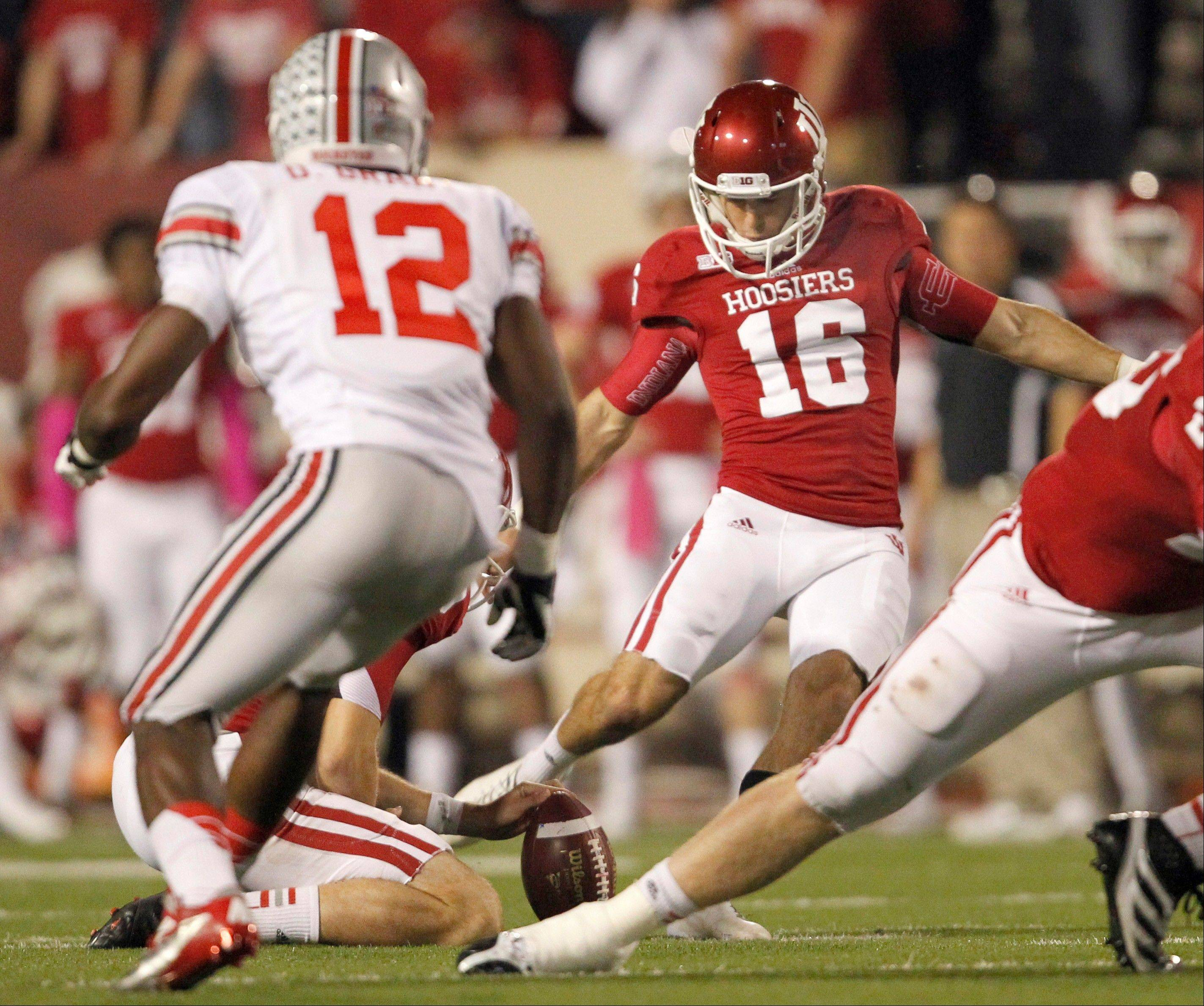 Indiana kicker Mitch Ewald (16) should break at least two IU records this season. The Waubonsie Valley kicker is among 127 players from area suburbs on FBS rosters to open the college football season.