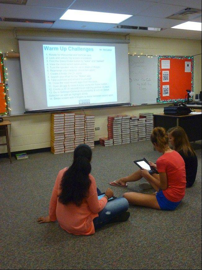Students at Fremd High School in Palatine work in groups to familiarize themselves with their iPad devices.