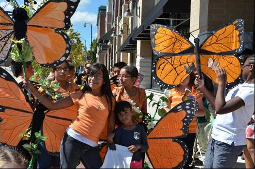 Children from the COOL Summer Learning Experience show off their homemade monarch butterflies at last year�s festival.