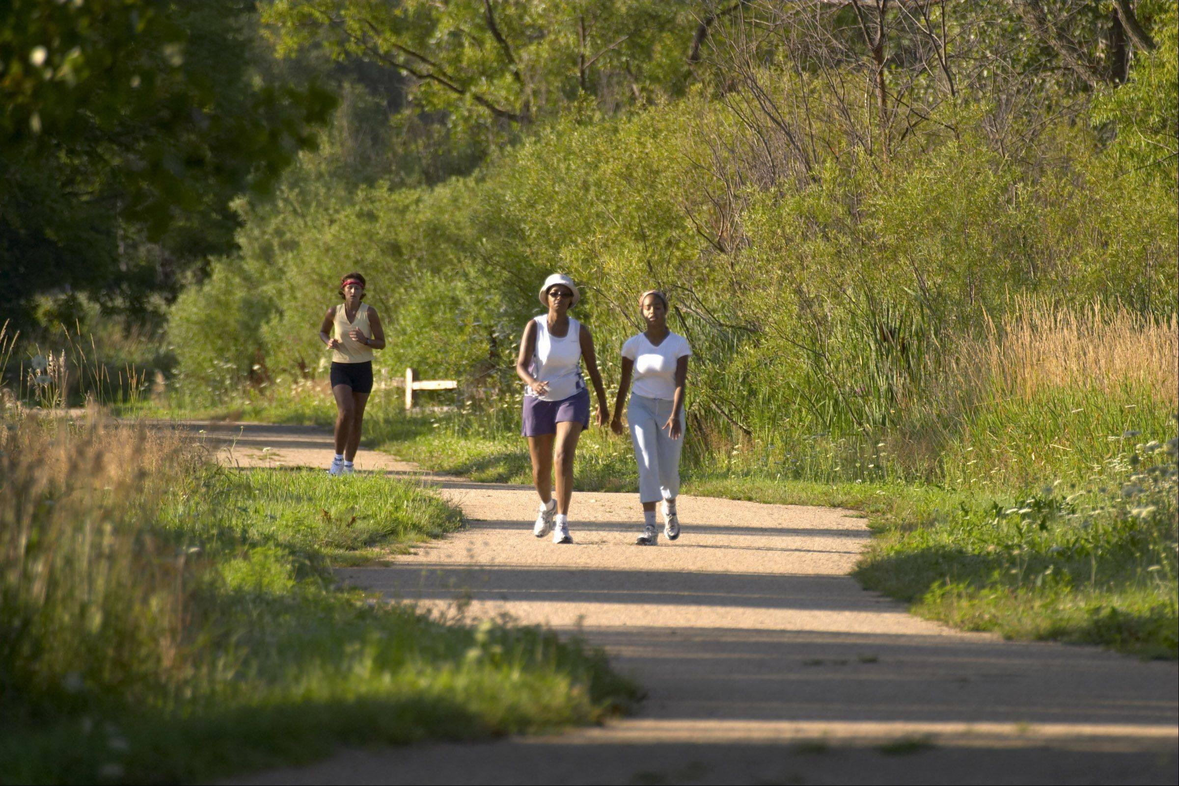 Hikers using the Middlefork Savannah trails near Lake Forest.