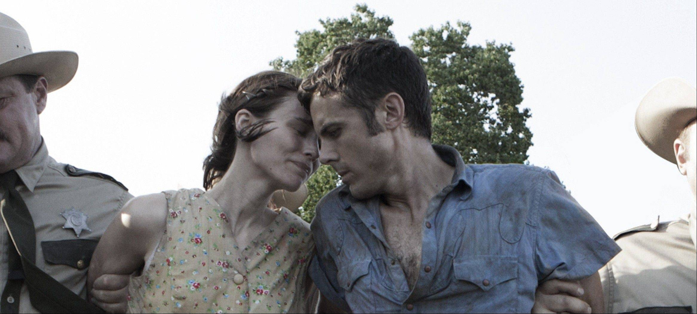 "Police arrest Texas outlaws Ruth Guthrie (Rooney Mara, left) and Bob Muldoon (Casey Affleck) in ""Ain't Them Bodies Saints."""